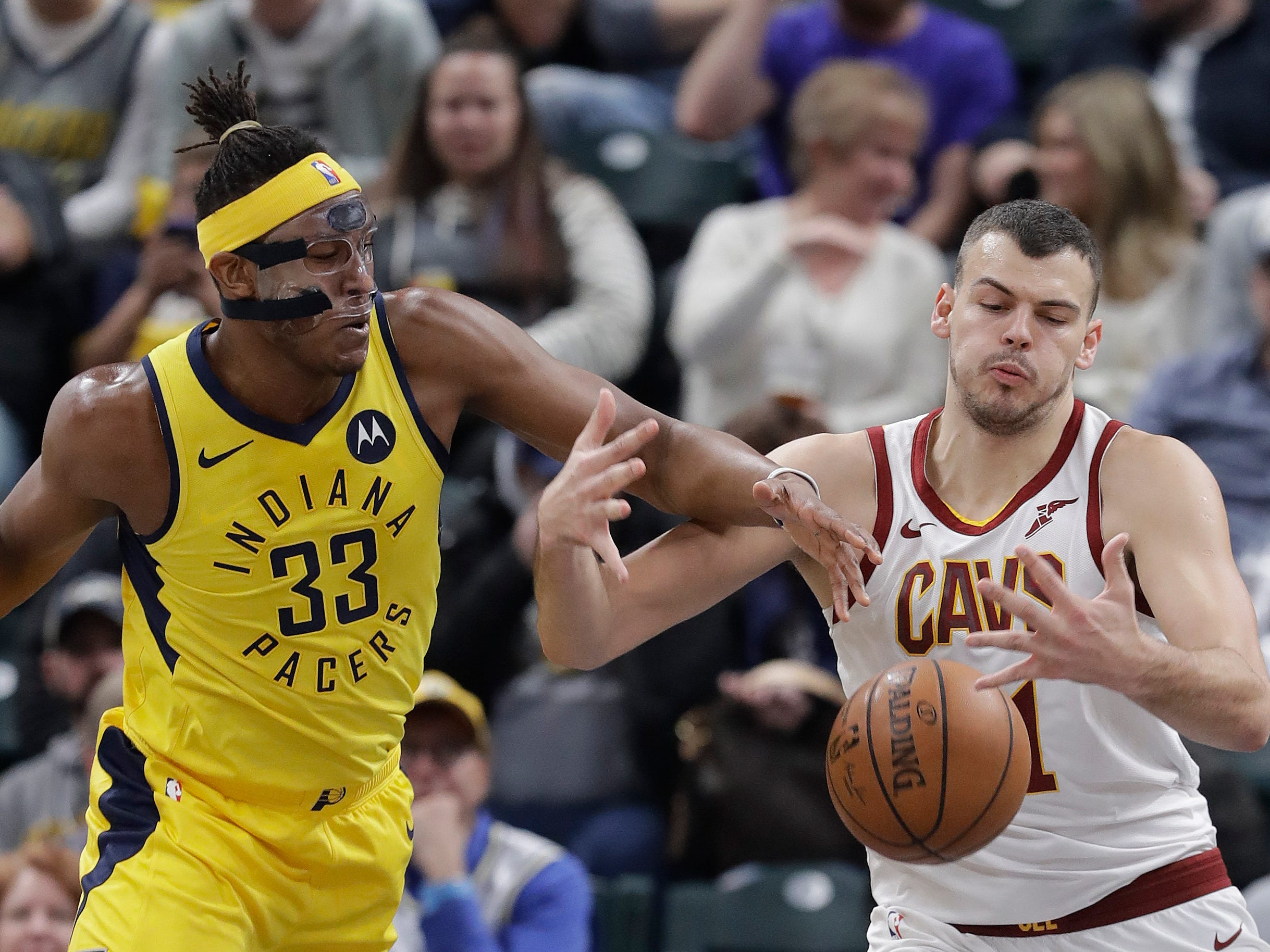 Indiana Pacers' Myles Turner and Cleveland Cavaliers' Ante Zizic battle for the ball during the first half.