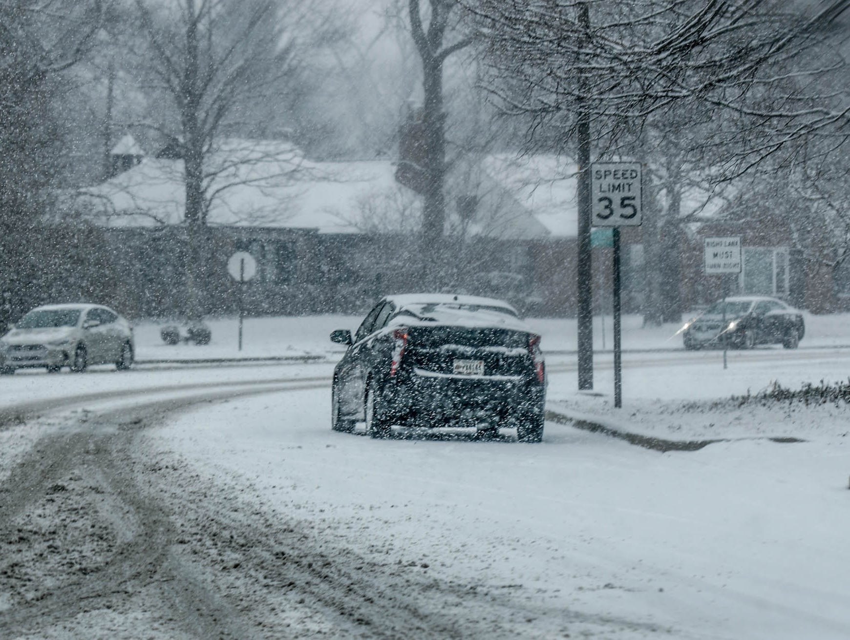 A Prius stalls along Kessler Blvd. W. Dr. as now falls in Indianapolis on Sunday, Feb. 10, 2019.