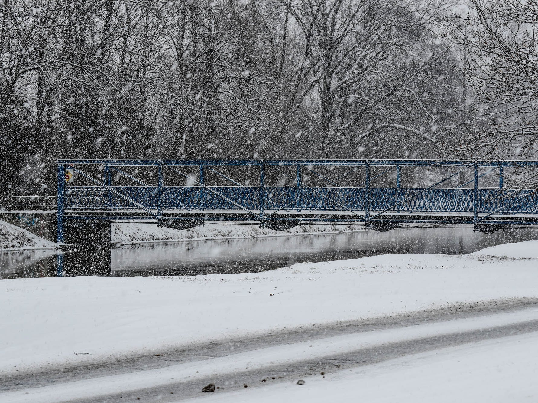 Snow falls along the canal near Broad Ripple in Indianapolis on Sunday, Feb. 10, 2019.