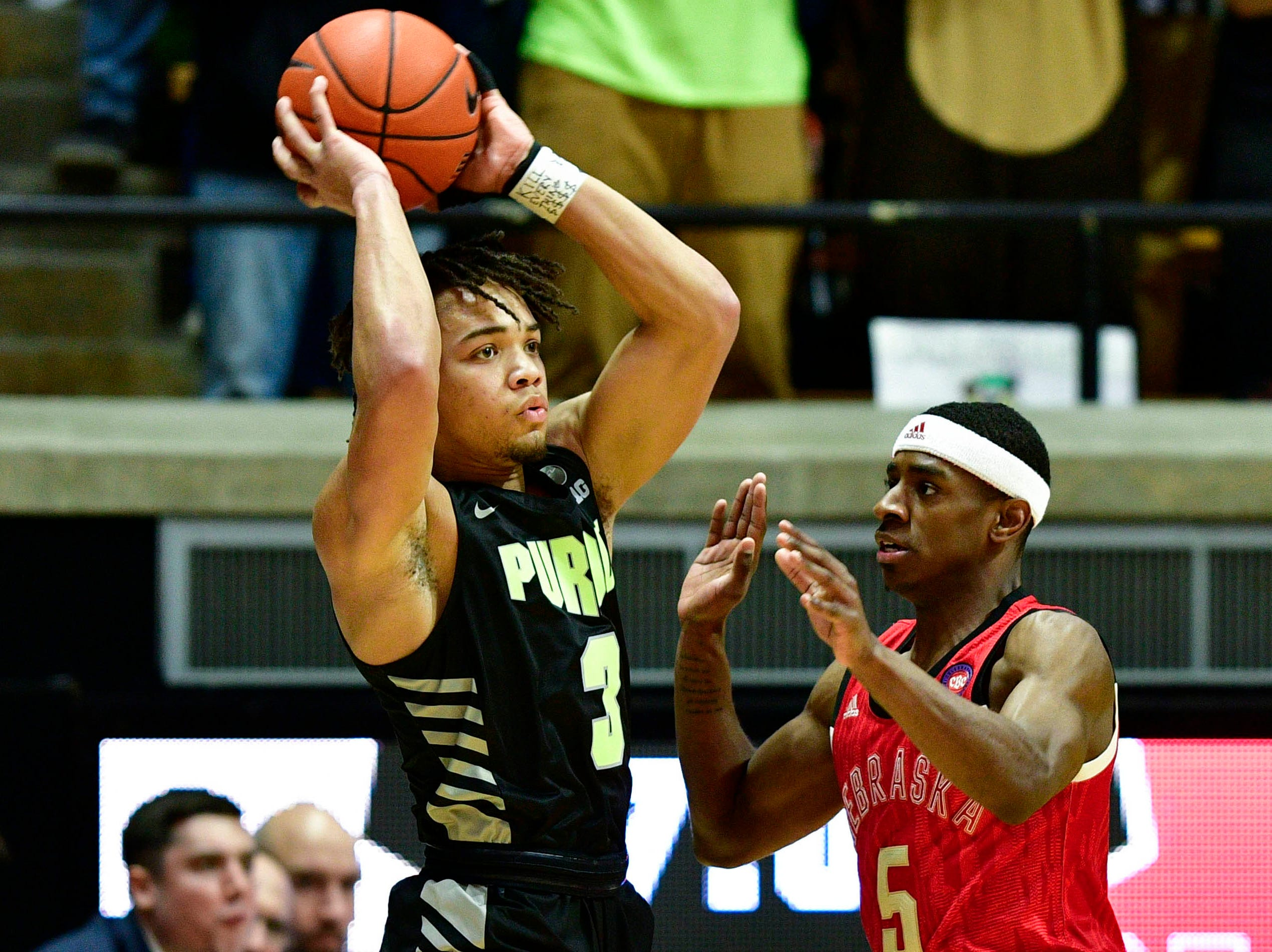 Purdue Boilermakers guard Eric Hunter Jr. (2) looks for an open teammate against Nebraska Cornhuskers guard Glynn Watson Jr. (5) during the first half of the game at Mackey Arena.