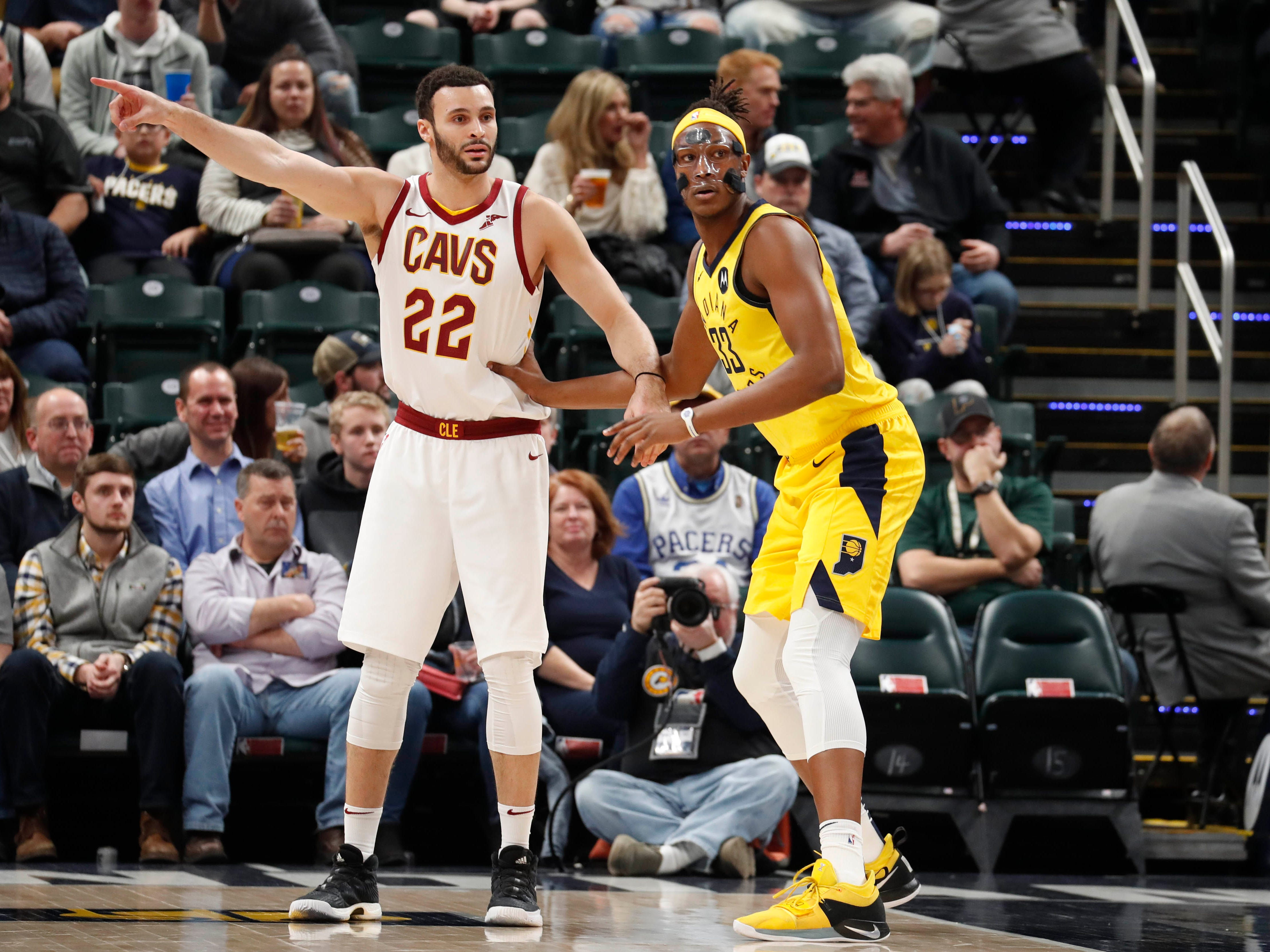 Feb 9, 2019; Indianapolis, IN, USA; Cleveland Cavaliers forward Larry Nance Jr. (22) is guarded by Indiana Pacers center Myles Turner (33) during the first quarter at Bankers Life Fieldhouse. Mandatory Credit: Brian Spurlock-USA TODAY Sports