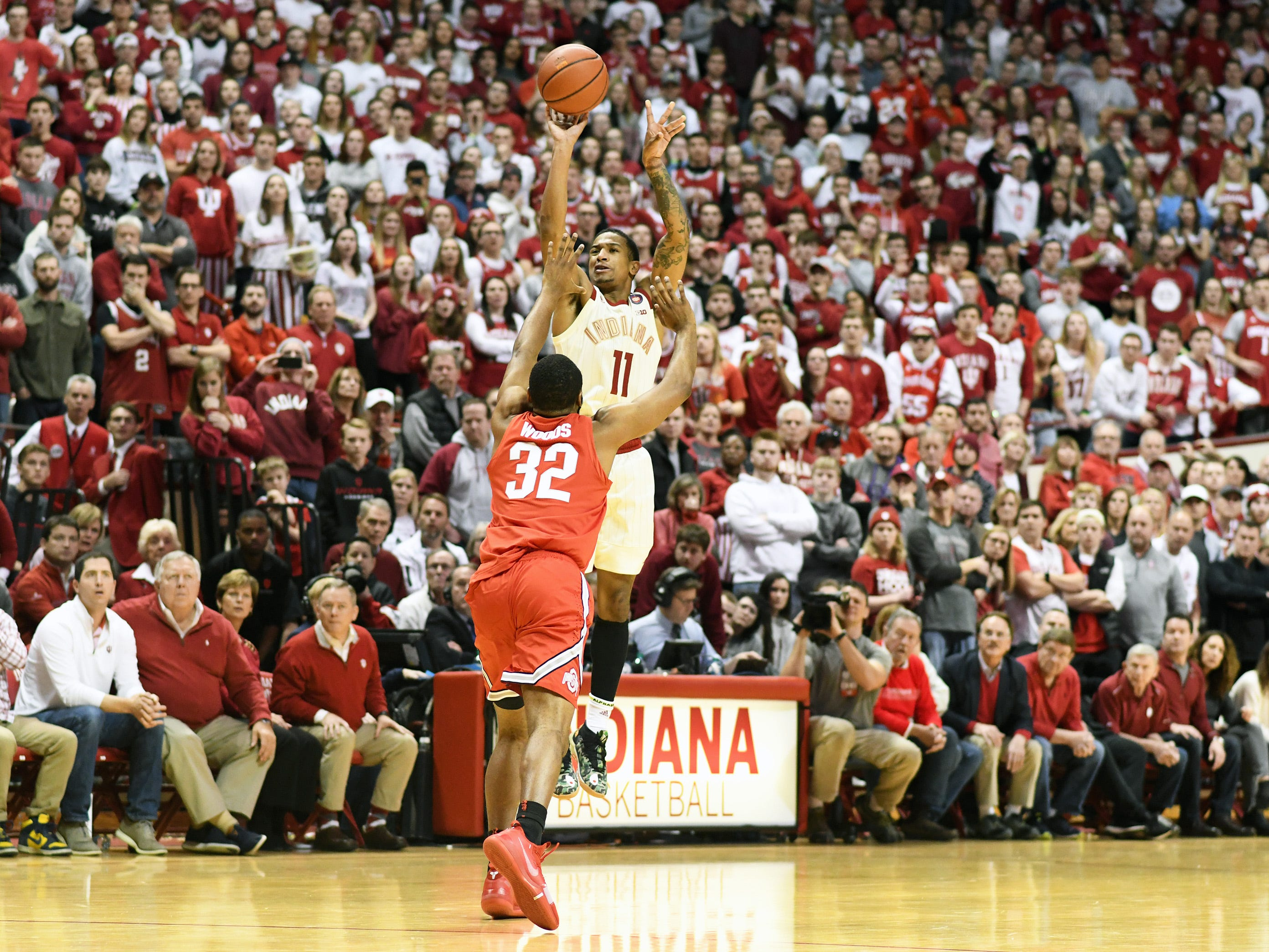 Indiana Hoosiers guard Devonte Green (11) makes a three-pointer during the game against Ohio State at Simon Skjodt Assembly Hall in Bloomington Ind., on Sunday, Feb. 10, 2019.