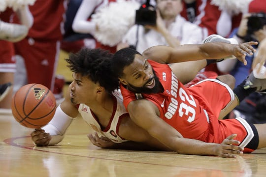 Indiana's Justin Smith, left, and Ohio State's Keyshawn Woods go for the ball during the first half of an NCAA college basketball game, Sunday, Feb. 10, 2019, in Bloomington, Ind. (AP Photo/Darron Cummings)