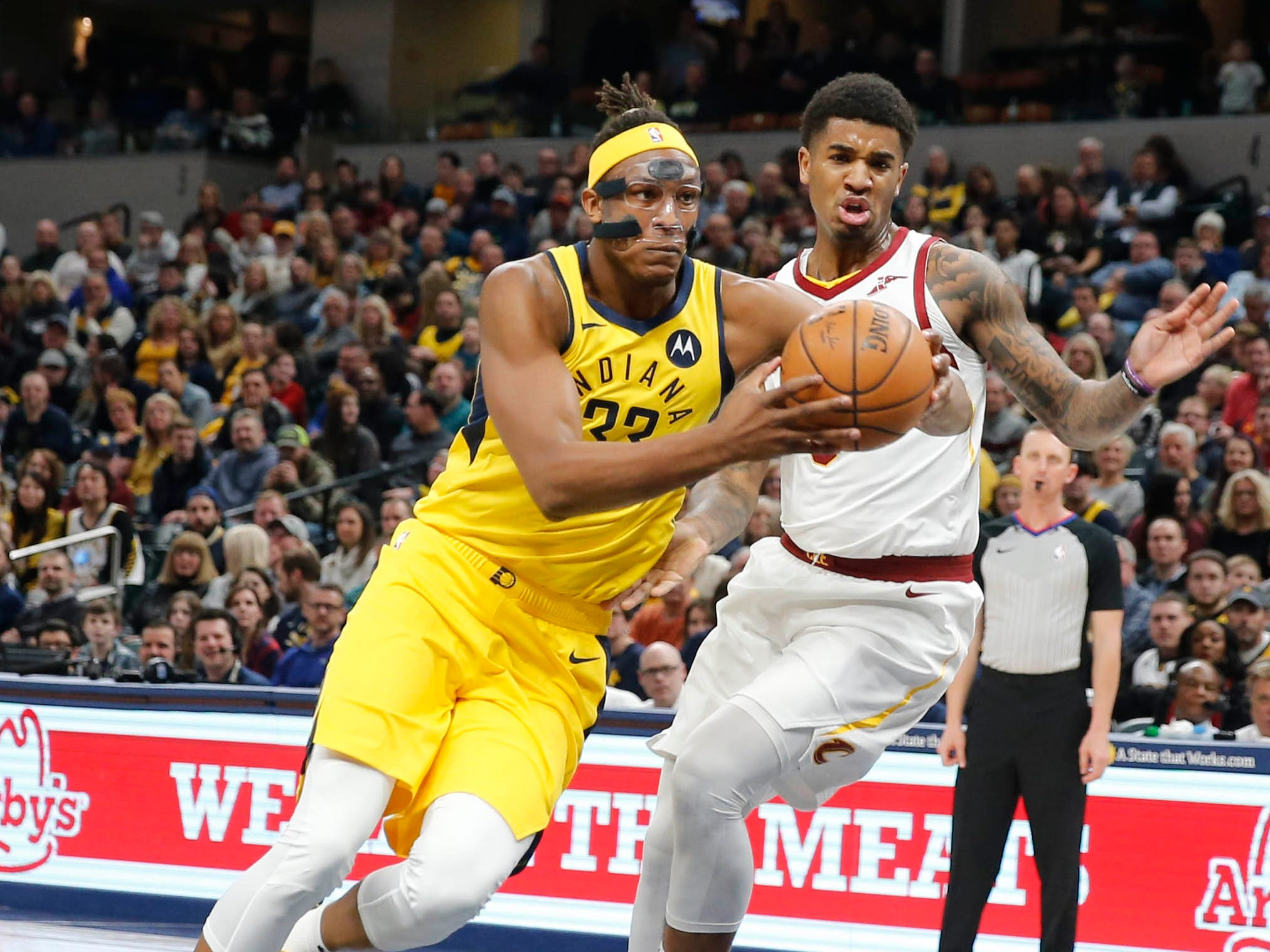 Feb 9, 2019; Indianapolis, IN, USA; Indiana Pacers center Myles Turner (33) drives to the basket against Cleveland Cavaliers center Marquese Chriss (3) during the first quarter at Bankers Life Fieldhouse. Mandatory Credit: Brian Spurlock-USA TODAY Sports