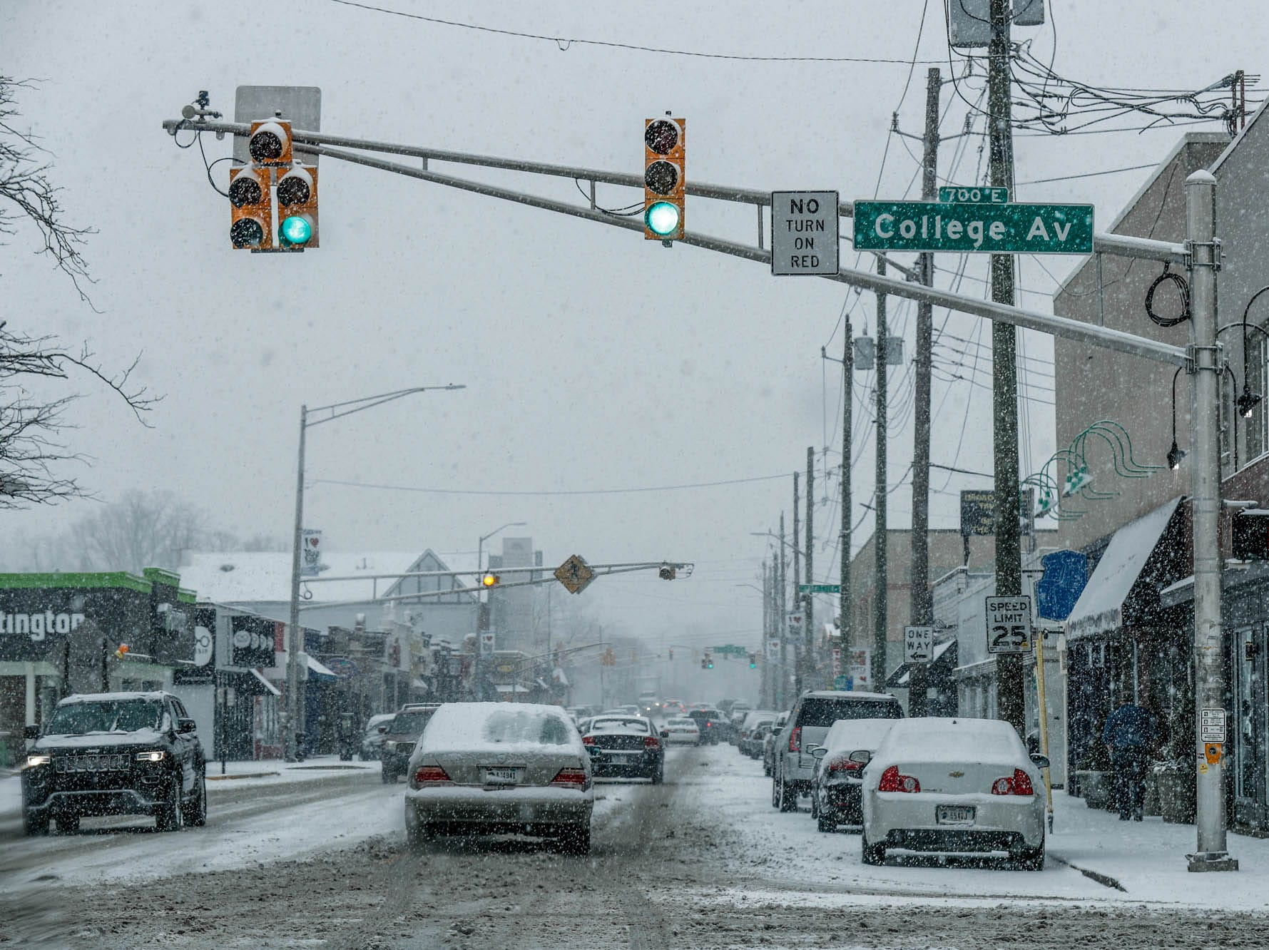 Snow falls in Broad Ripple Village in Indianapolis on Sunday, Feb. 10, 2019.