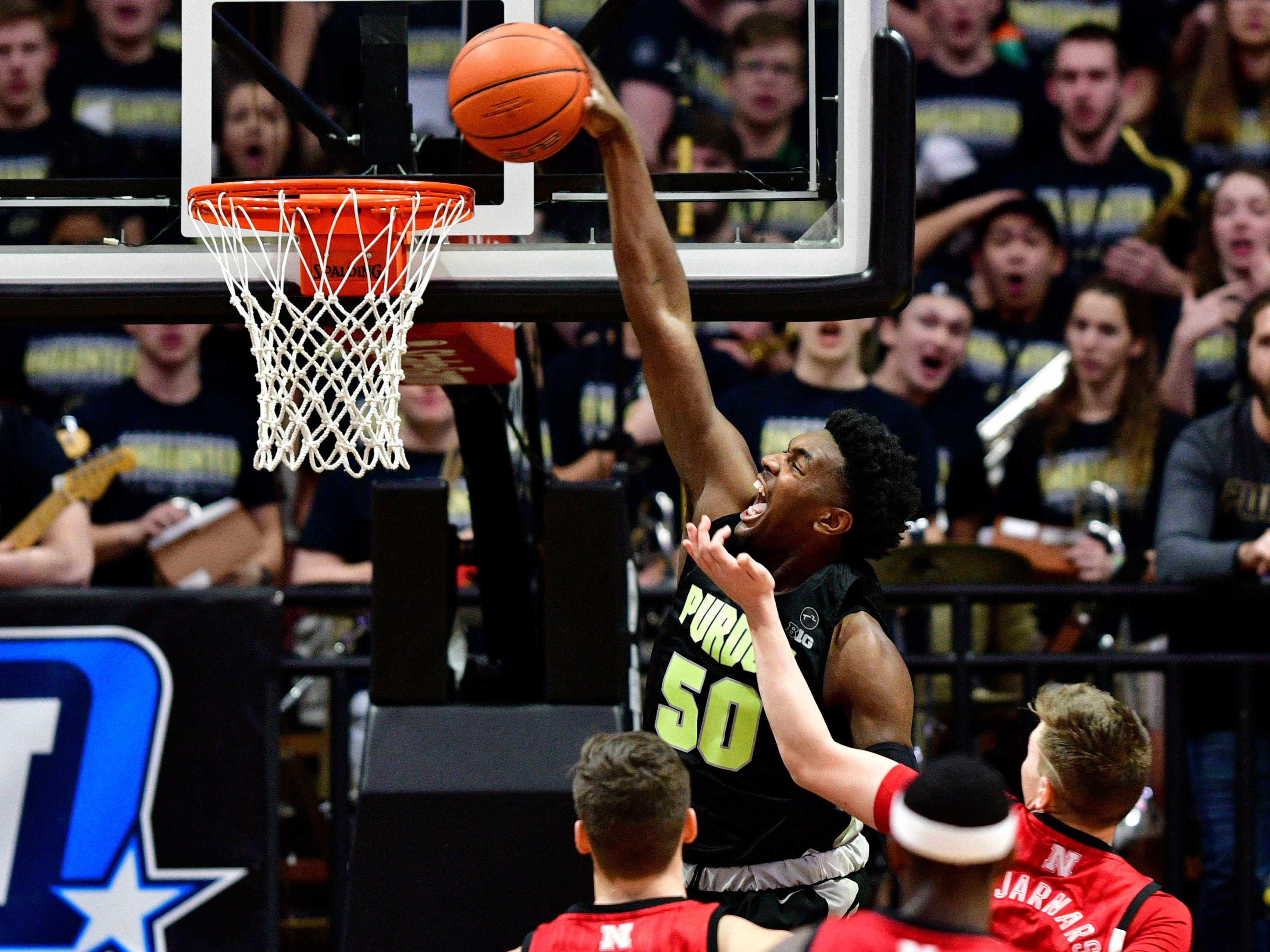 Purdue Boilermakers forward Trevion Williams (50) dunks the ball against several Nebraska Cornhuskers during the first half of the game at Mackey Arena.