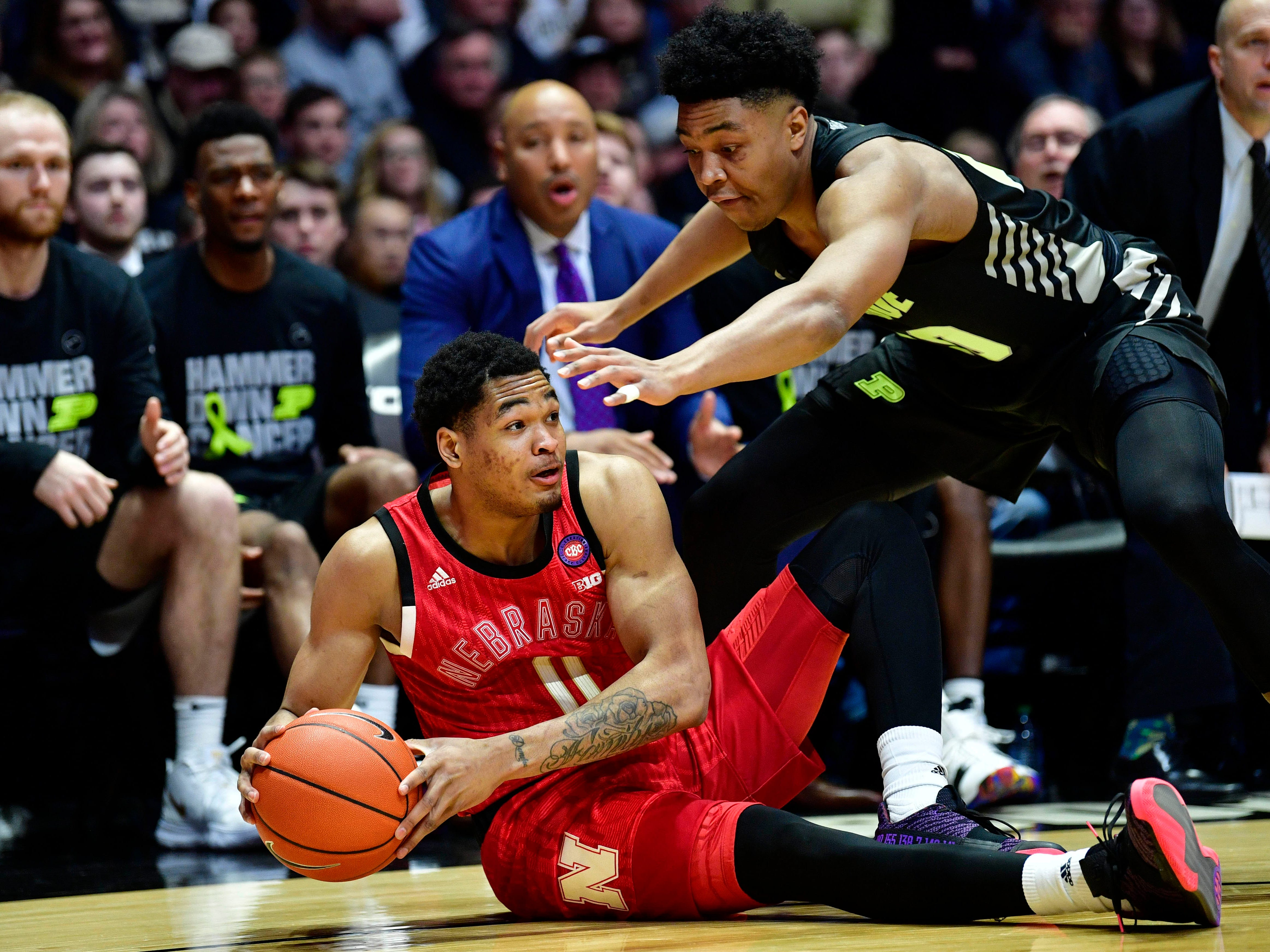 Nebraska Cornhuskers guard James Palmer Jr. (0) attempts to keep a down ball away from Purdue Boilermakers guard Nojel Eastern (20) during the first half of the game a