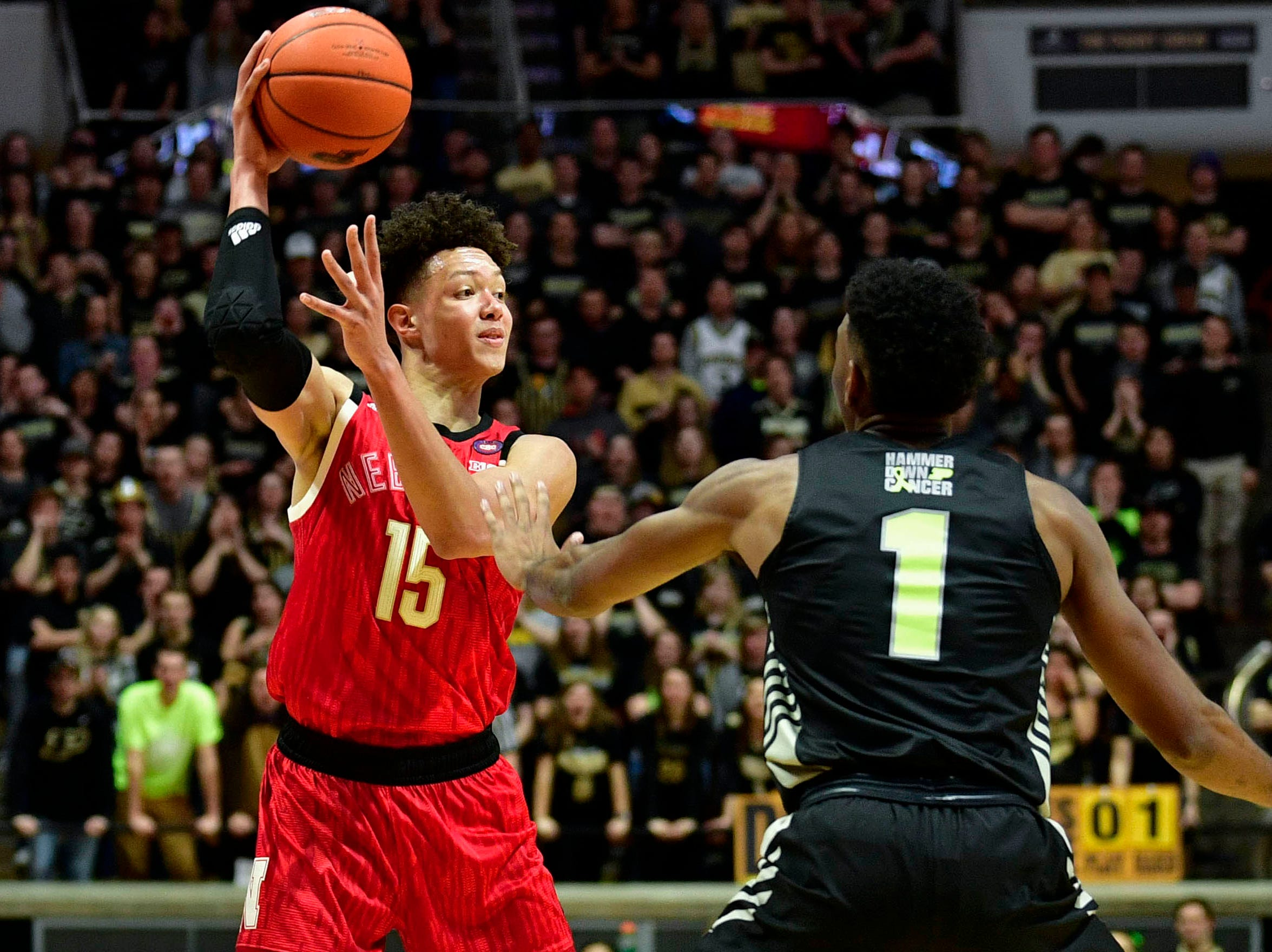 Nebraska Cornhuskers forward Isaiah Roby (15) looks for a teammate past Purdue Boilermakers forward Aaron Wheeler (1) during the first half of the game at Mackey Arena.