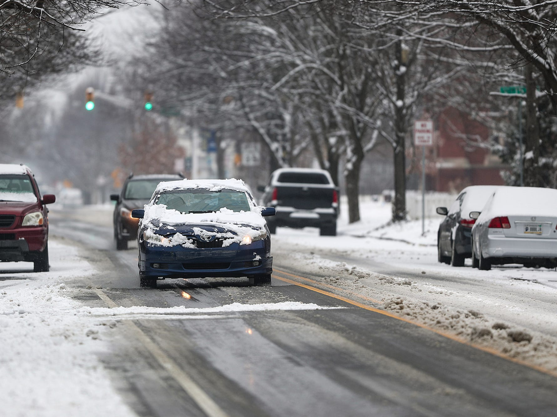 A stretch of Central Avenue is covered in wet snow, north of downtown Indianapolis on Sunday, Feb. 10, 2019. According to the National Weather Service, heavy rain Monday into Tuesday might worsen flooding in some areas already effected by last week's precipitation.