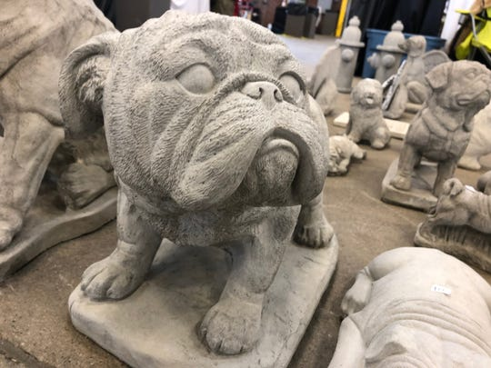 A piece of concrete dog yard art from the Norma's Yard Art vendor booth at the Indy Winter Classic