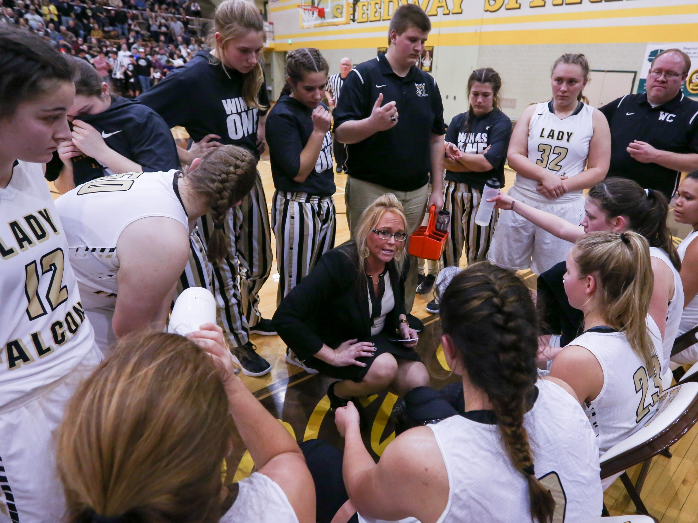 Winchester Community Coach Holly Gutierrez lays out plans to the team during the first half of Western Boone vs. Winchester Community high school girls varsity 2A Regional basketball tournament held at Speedway High School, February 9, 2019.