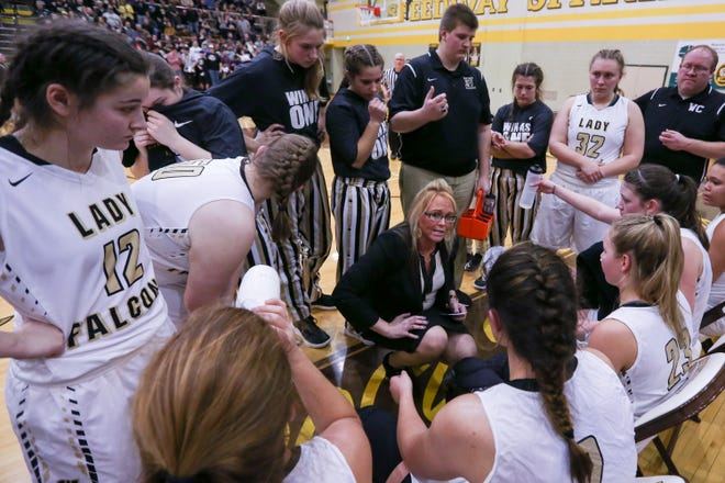 Winchester coach Holly Gutierrez, shown here instructing her team during the regional championship, is 84-24 over four years with the Golden Falcons.
