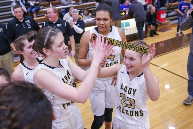 The Winchester Falcons celebrate their win at the Western Boone vs. Winchester Community high school girls varsity 2A Regional basketball tournament held at Speedway High School, February 9, 2019.