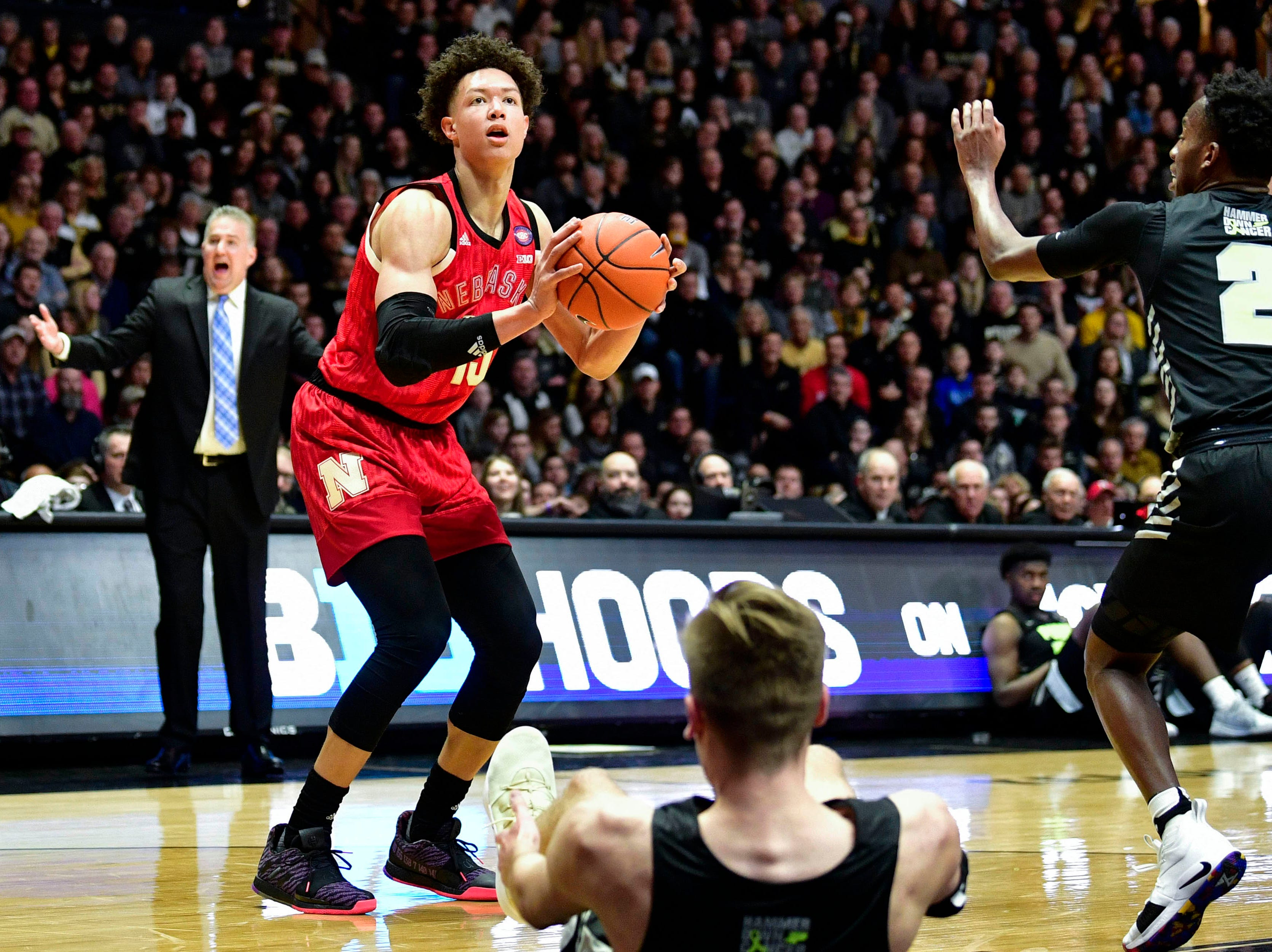 Nebraska Cornhuskers forward Isaiah Roby (15) attempts a shot over a downed Purdue Boilermakers center Matt Haarms (32) during the first half of the game at Mackey Arena.