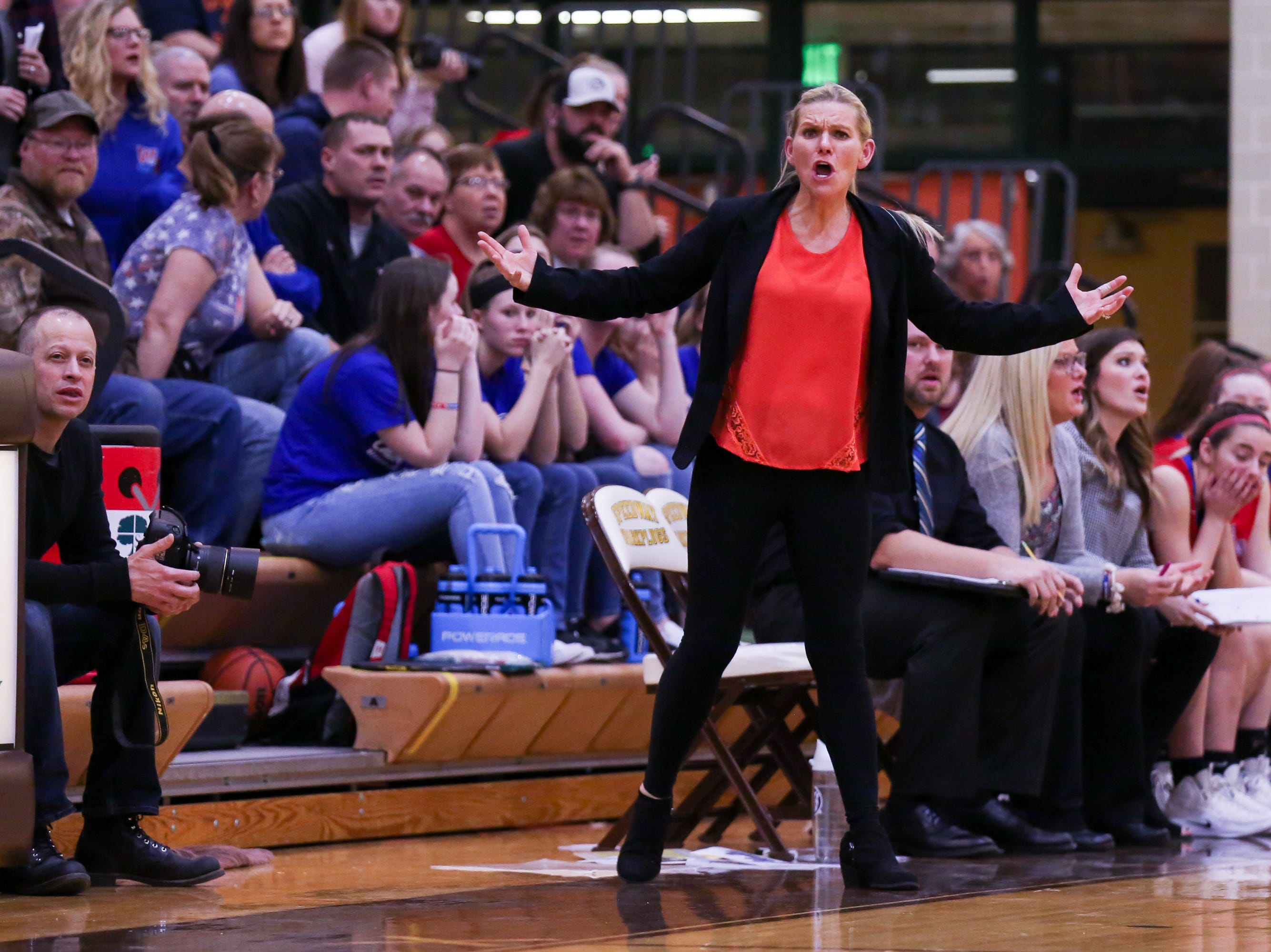 Western Boone Coach Megan Alexander questions an officials call during the second half of Western Boone vs. Winchester Community high school girls varsity 2A Regional basketball tournament held at Speedway High School, February 9, 2019.
