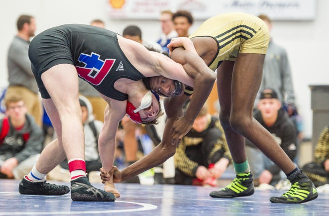 FILE – Roncalli's Brayden Lowery (left) was one of four individual semistate champions for the Rebels on Saturday.