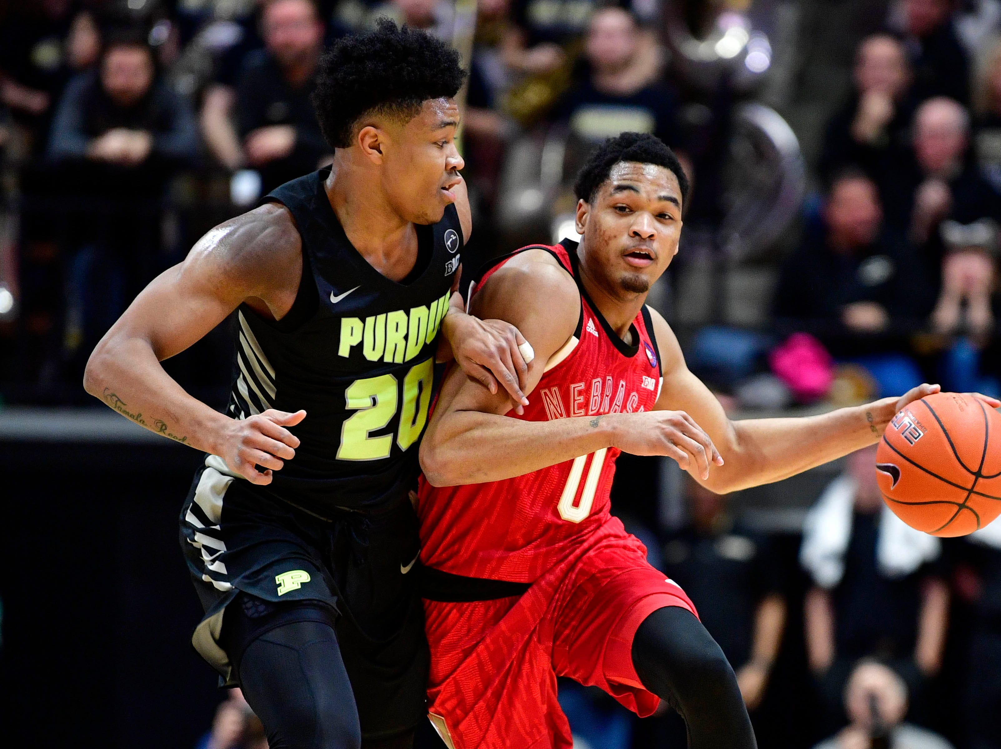 Nebraska Cornhuskers guard James Palmer Jr. (0) drives the ball down court against Purdue Boilermakers guard Nojel Eastern (20) during the first half of the game at Mackey Arena.