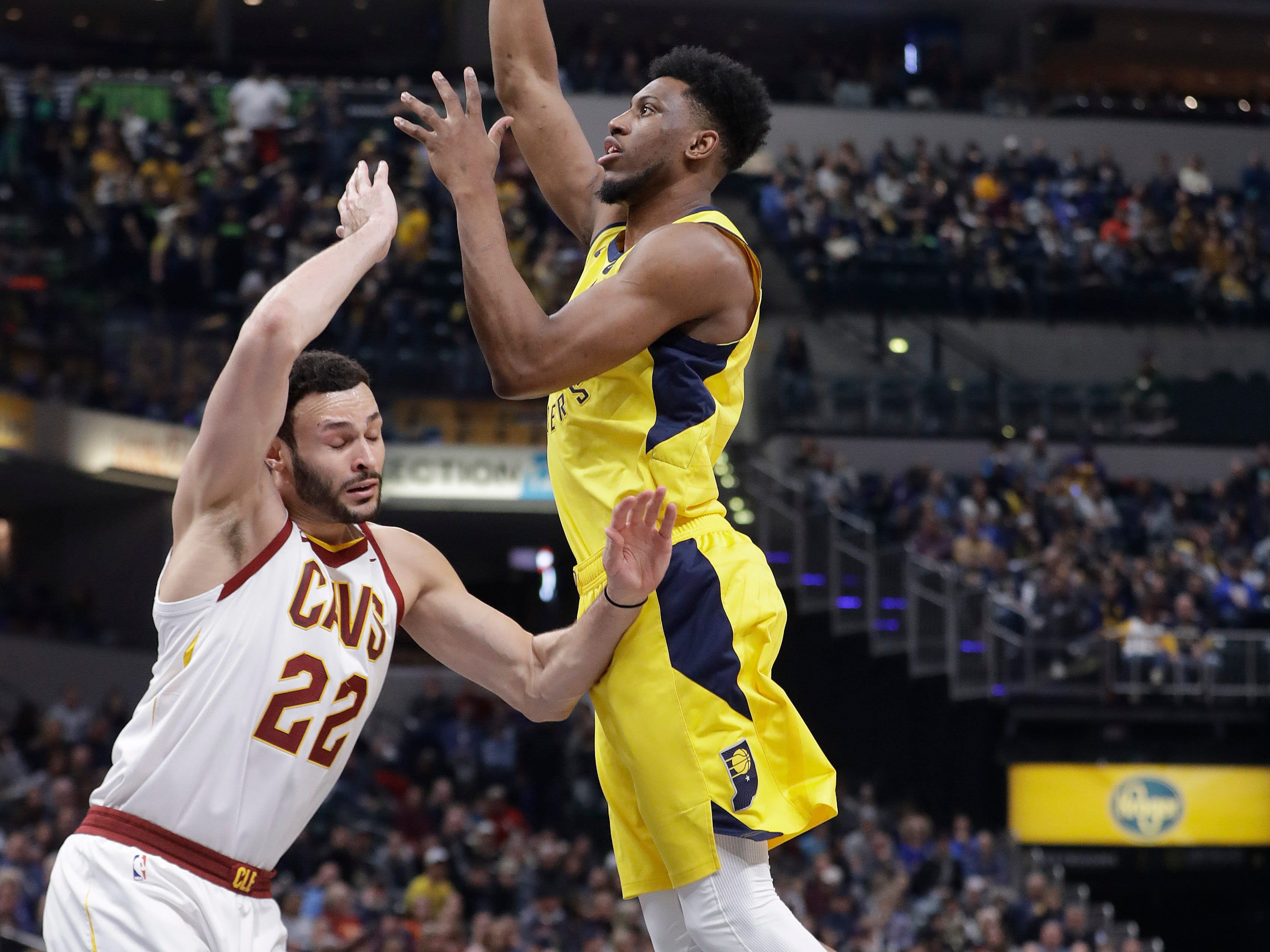 Indiana Pacers' Thaddeus Young shoots over Cleveland Cavaliers' Larry Nance Jr. during the first half.
