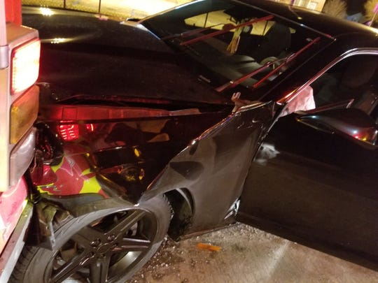 A man was arrested after crashing his car into a fire truck