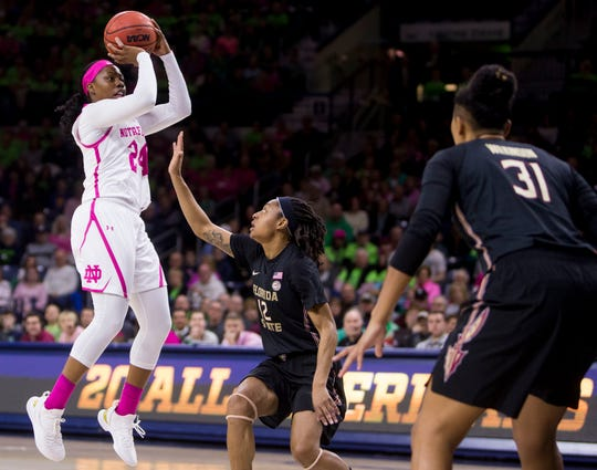 Notre Dame's Arike Ogunbowale (24) shots in front of Florida State's Nicki Ekhomu (12) during the first half of an NCAA college basketball game Sunday, Feb. 10, 2019, in South Bend, Ind.