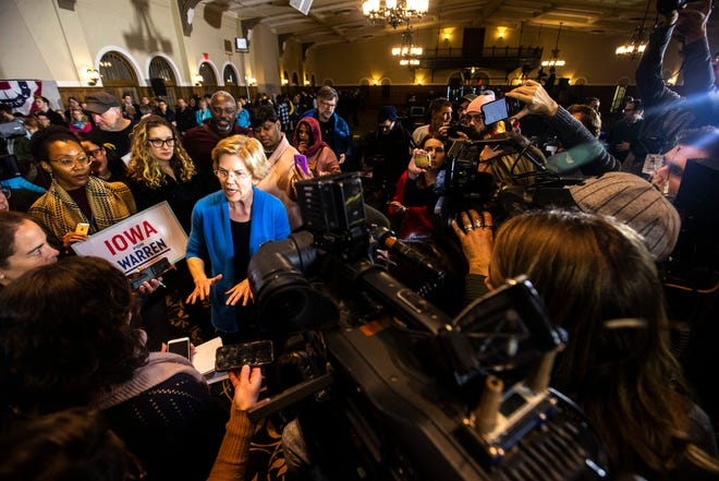 U.S. Sen. Elizabeth Warren, D-Mass, speaks to reporters during a campaign stop on Sunday, Feb. 10, 2019 at Iowa Memorial Union on the University of Iowa campus in Iowa City, Iowa.