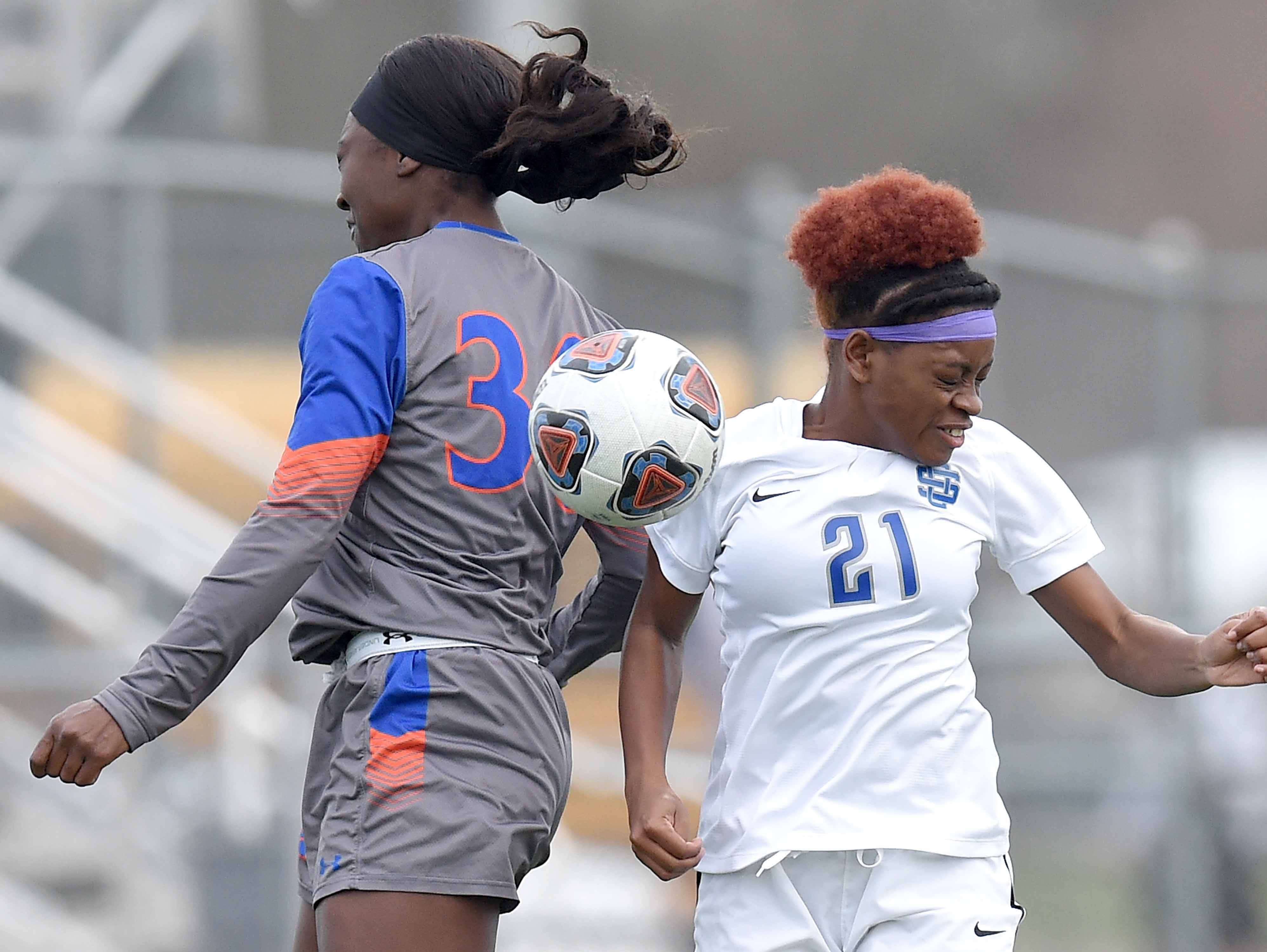 Madison Central's Cariel Ellis (30) and Ocean Springs' Loren Winters (21) go up for a header in the Class 6A state championship in the MHSAA BlueCross Blue Shield of Mississippi Soccer Classic on Saturday, February 9, 2019, at Ridgeland High School in Ridgeland, Miss.