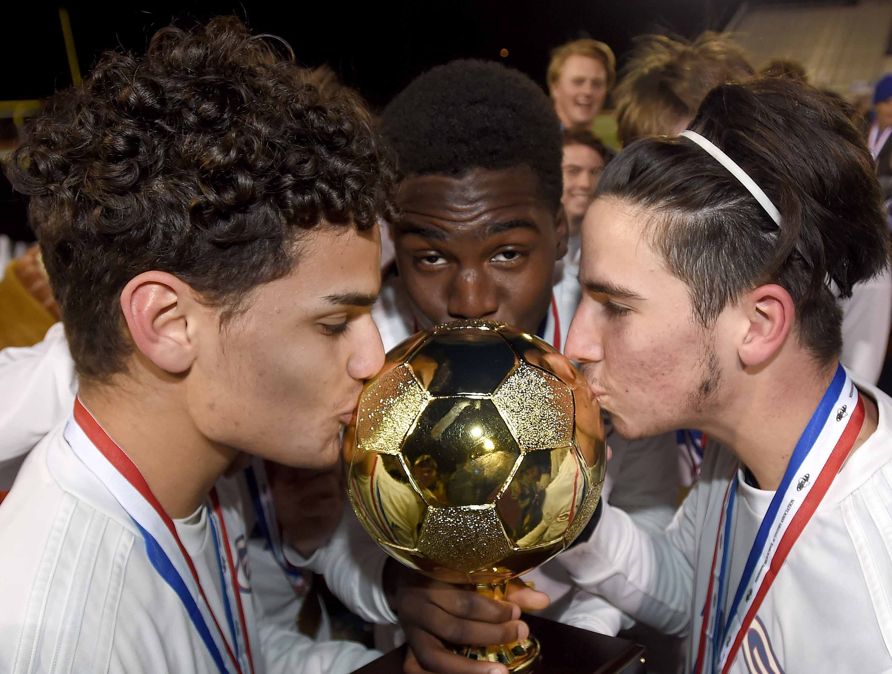 The Gulfport Admirals kiss the Class 6A state championship trophy after defending their 2018 state title beating Northwest Rankin 2-1 in the MHSAA BlueCross Blue Shield of Mississippi Soccer Classic on Saturday, February 9, 2019, at Ridgeland High School in Ridgeland, Miss.