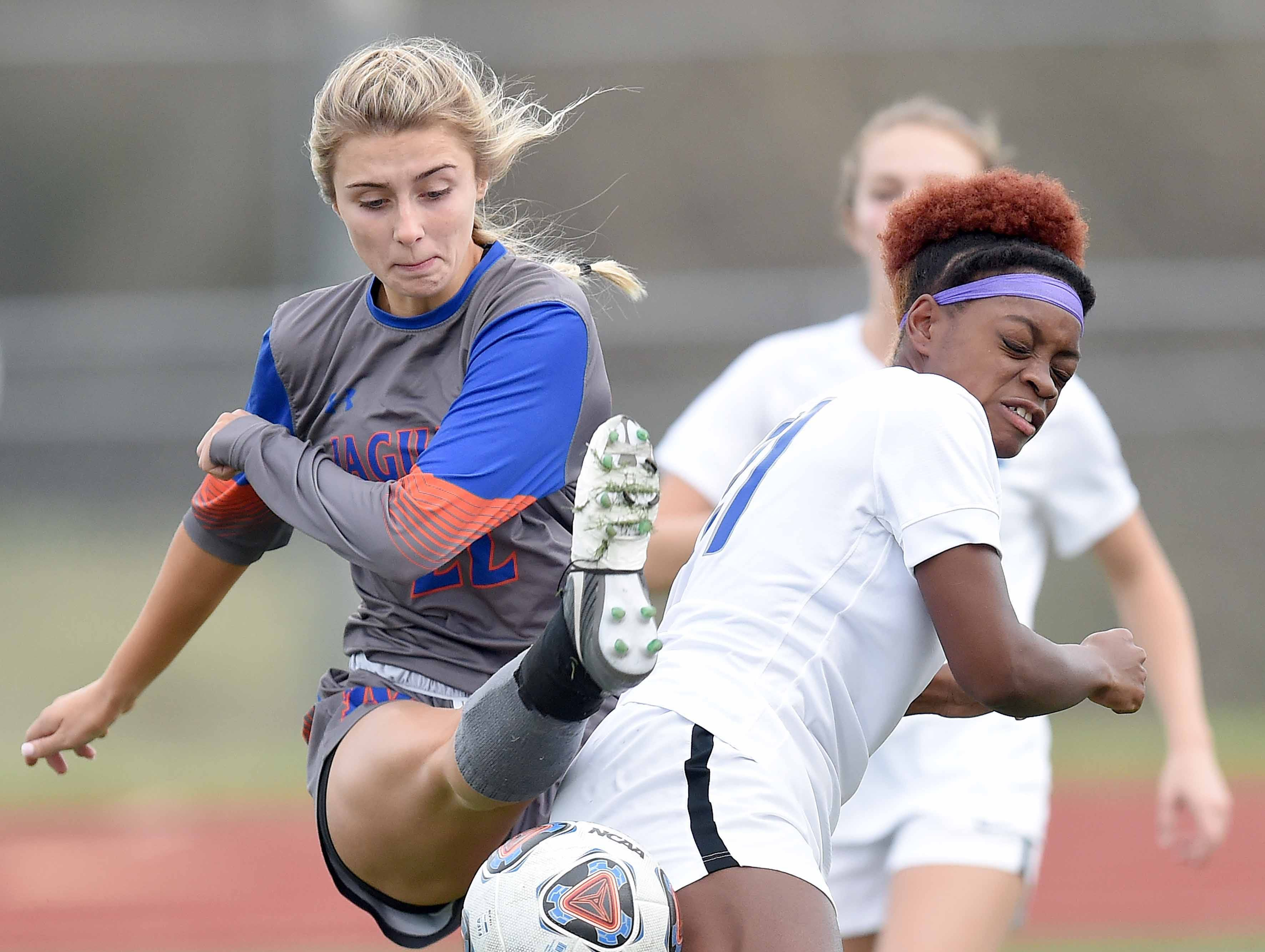 Madison Central's Cara Dale Palmer (22) blocks the pass to Ocean Springs' Loren Winters (right) in the Class 6A state championship in the MHSAA BlueCross Blue Shield of Mississippi Soccer Classic on Saturday, February 9, 2019, at Ridgeland High School in Ridgeland, Miss.