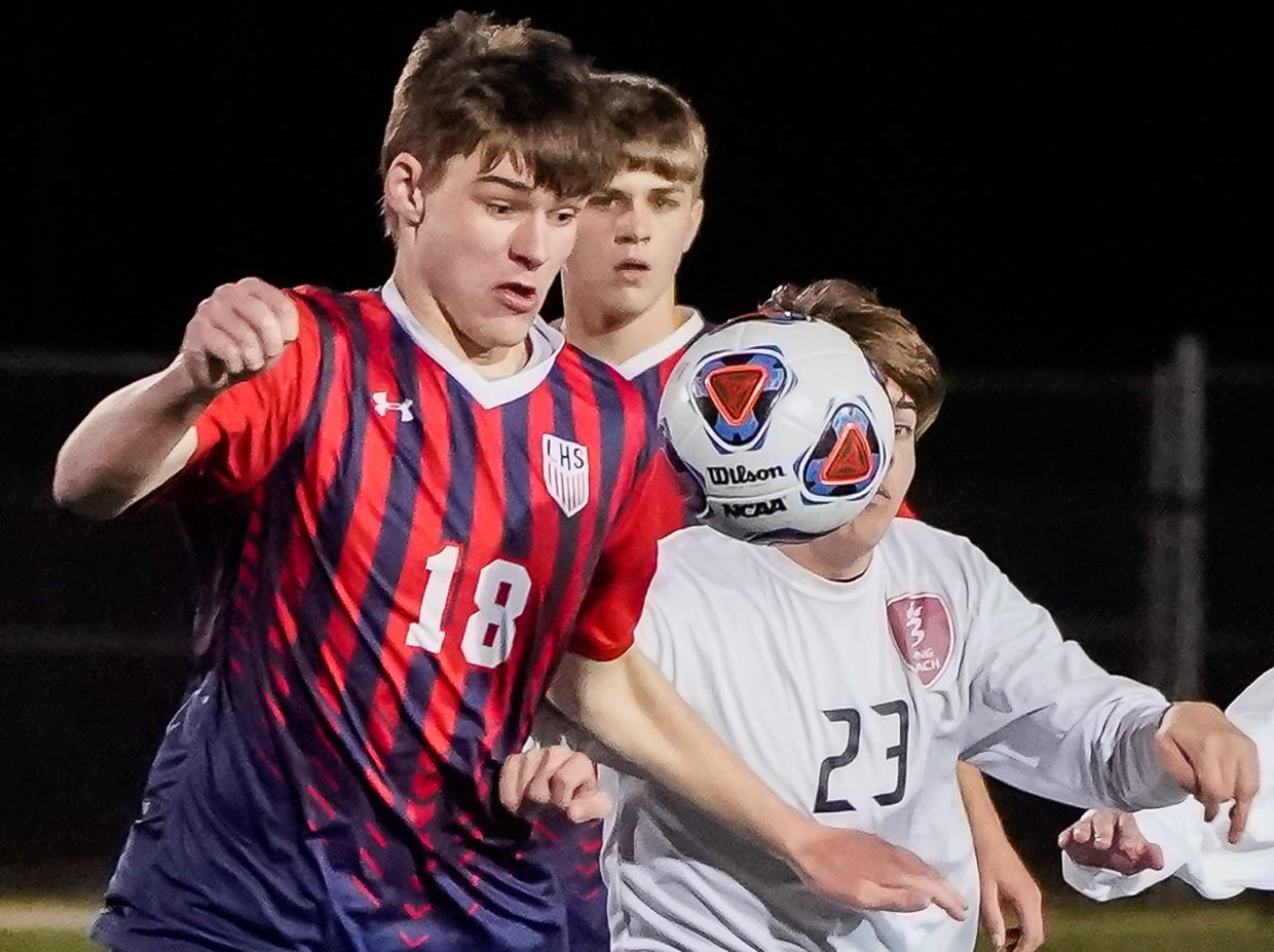 Lewisburg's Connor Murphy (18) bumps a ball away from Long Beach's Connor Clarke (23) during the MHSAA 5A Boys Soccer Championships held at Brandon High School in Brandon, MS, Saturday February 9, 2019.(Bob Smith-For The Clarion Ledger)