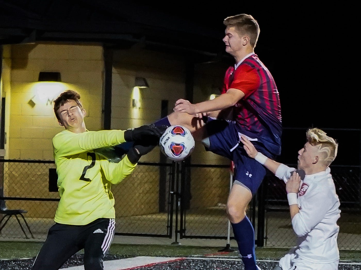 Long Beach keeper Justin Rollson (2) saves a ball against Lewisburg's Aaron Cooke during the MHSAA 5A Boys Soccer Championships held at Brandon High School in Brandon, MS, Saturday February 9, 2019.(Bob Smith-For The Clarion Ledger)
