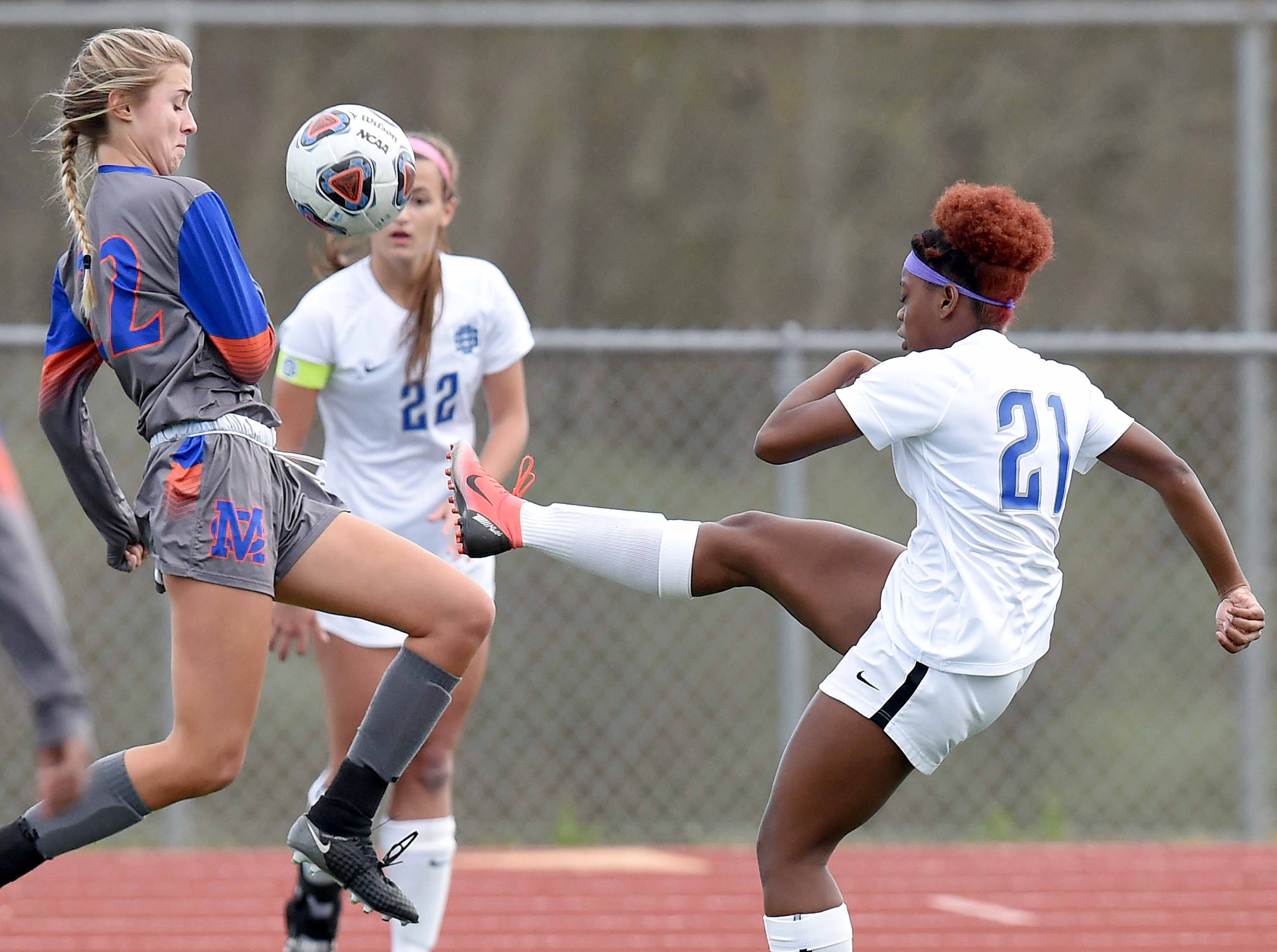 Ocean Springs' Loren Winters (21) clears the ball past Madison Central's Cara Dale Palmer (22) in the Class 6A state championship in the MHSAA BlueCross Blue Shield of Mississippi Soccer Classic on Saturday, February 9, 2019, at Ridgeland High School in Ridgeland, Miss.