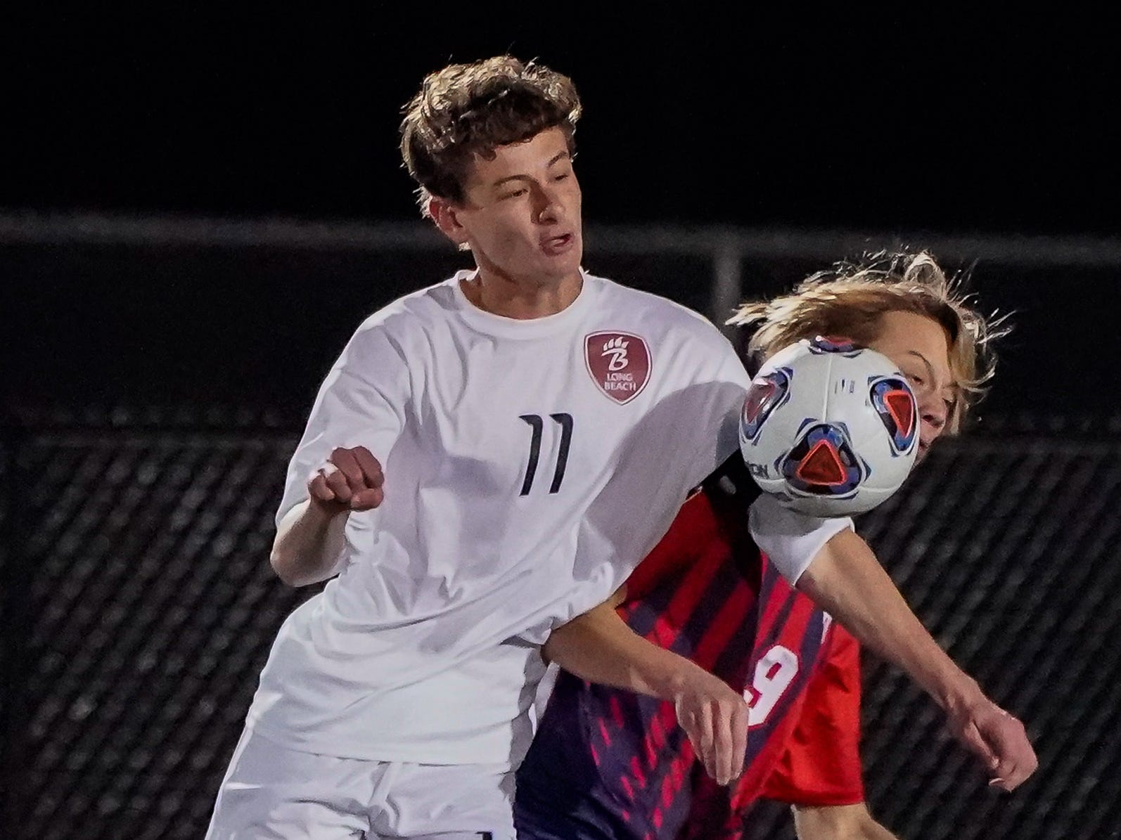 Lewisburg's Brendon Galbraith (9) tries to hold off Long Beach's Chase Dedeaux (11) during the MHSAA 5A Boys Soccer Championships held at Brandon High School in Brandon, MS, Saturday February 9, 2019.(Bob Smith-For The Clarion Ledger)