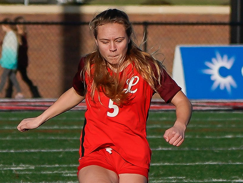Lafayette's Avery Treloar (5) kicks a ball against Long Beach during the MHSAA 5A Girls Soccer Championships held at Brandon High School in Brandon, MS, Saturday February 9, 2019.(Bob Smith-For The Clarion Ledger)