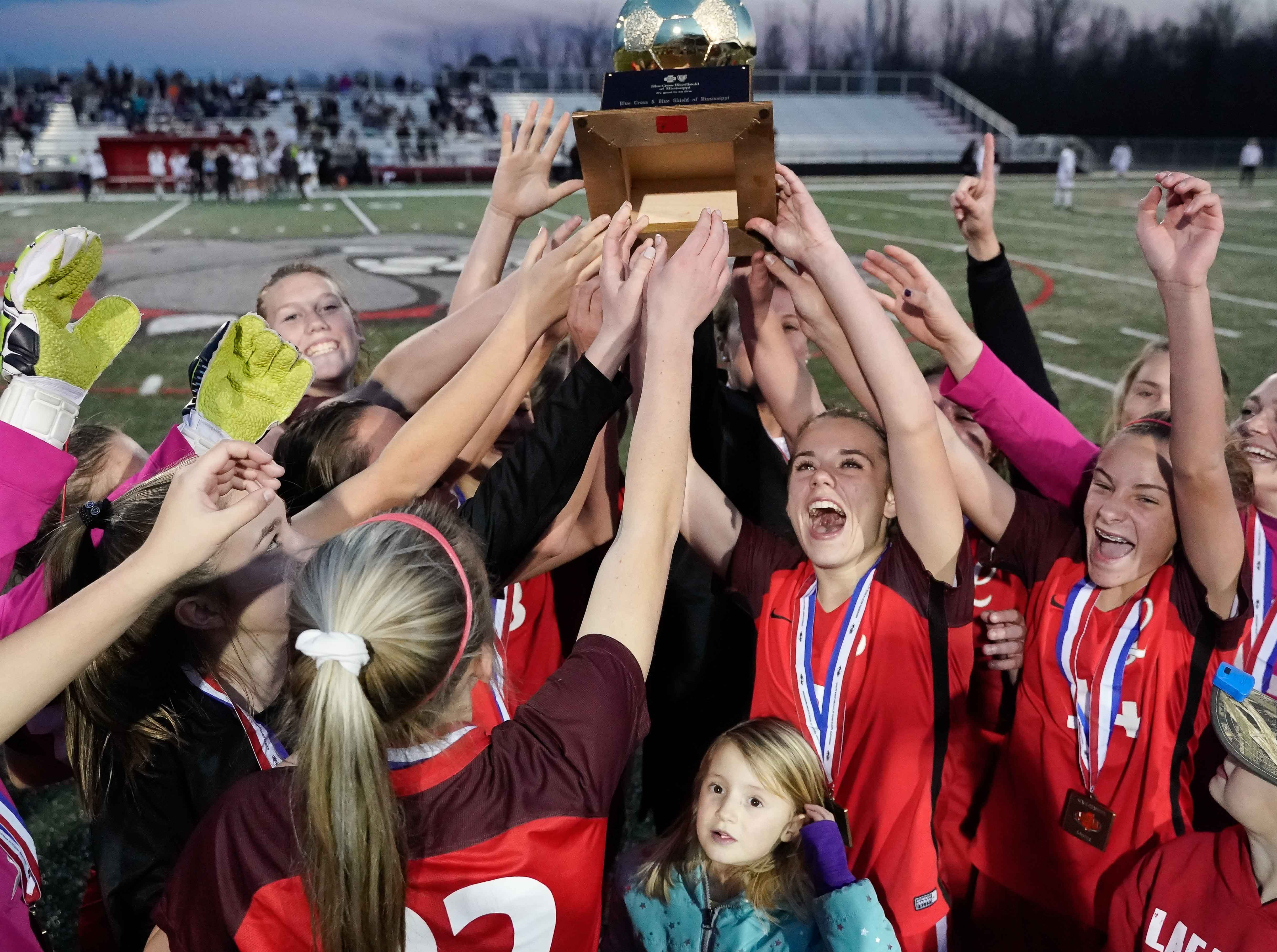Lafayette girls celebrate with the trophy folllowing their 5-1 win against Long Beach during the MHSAA 5A Girls Soccer Championships held at Brandon High School in Brandon, MS, Saturday February 9, 2019.(Bob Smith-For The Clarion Ledger)