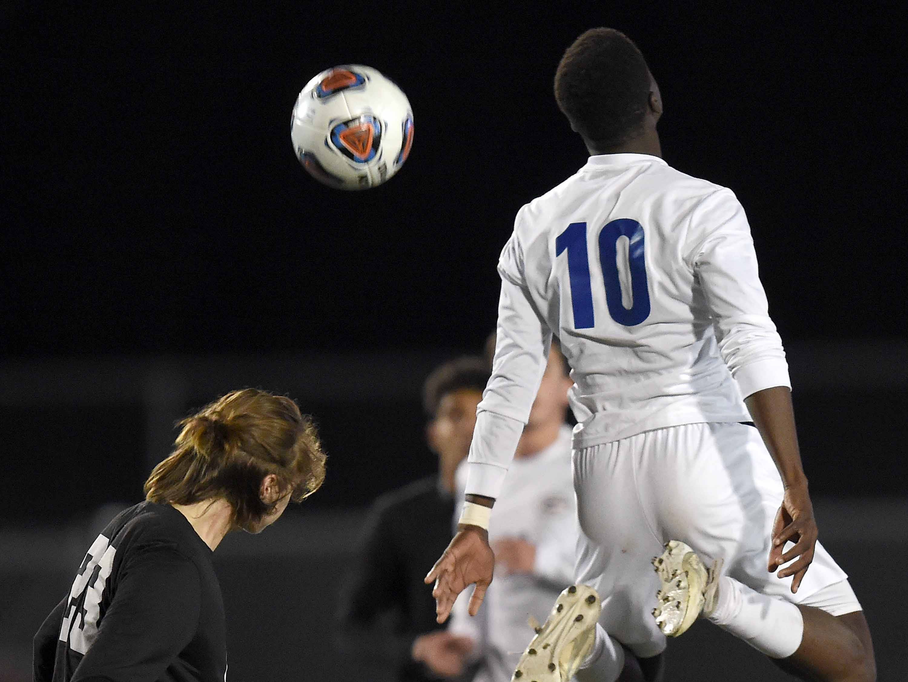 Northwest Rankin's Caden King (left) heads the ball past Gulfport's Mohamed Diallo (10) in the Class 6A state championship in the MHSAA BlueCross Blue Shield of Mississippi Soccer Classic on Saturday, February 9, 2019, at Ridgeland High School in Ridgeland, Miss.