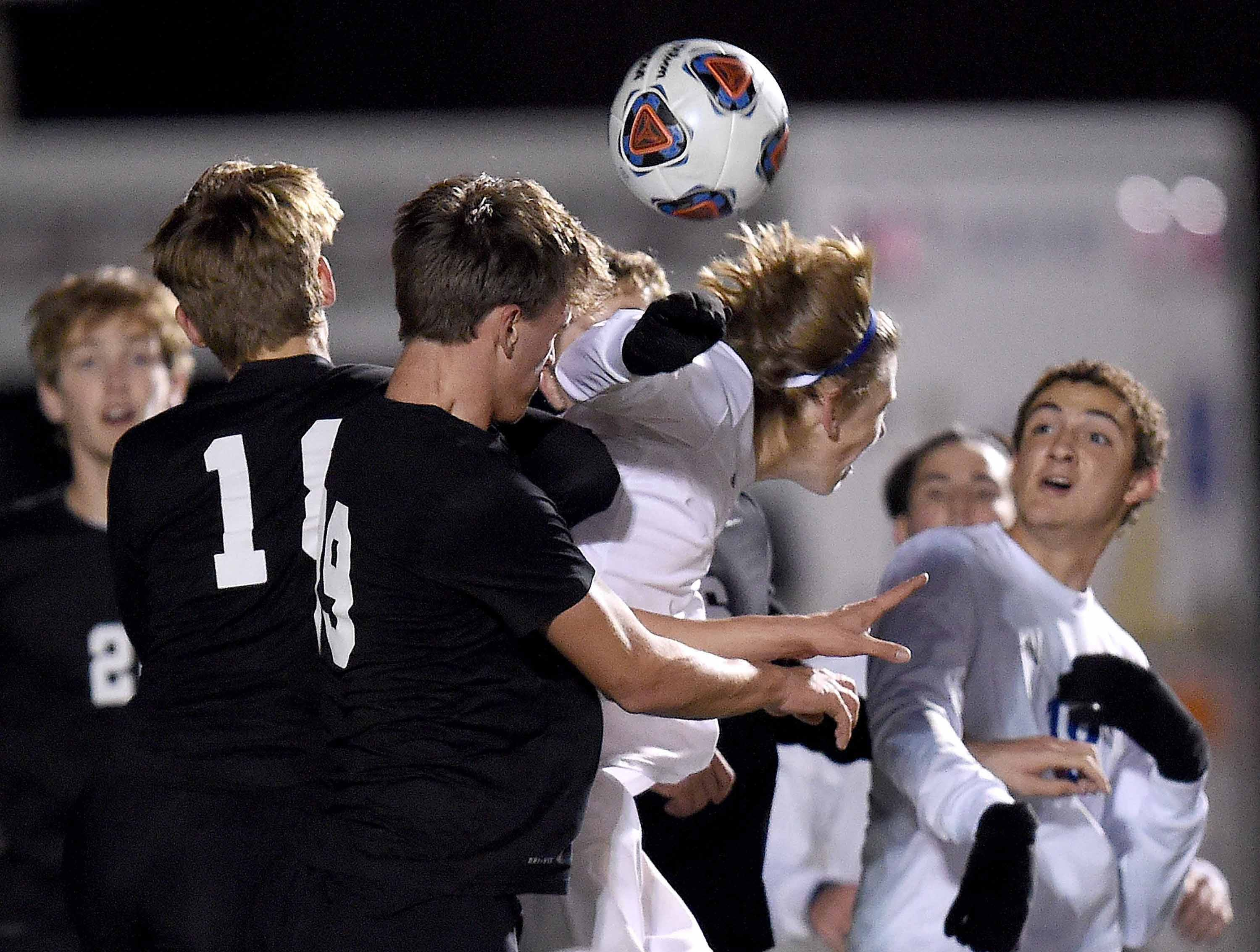 A crowd goes for the header to a ball in the box from a corner kick in the Class 6A state championship in the MHSAA BlueCross Blue Shield of Mississippi Soccer Classic on Saturday, February 9, 2019, at Ridgeland High School in Ridgeland, Miss.