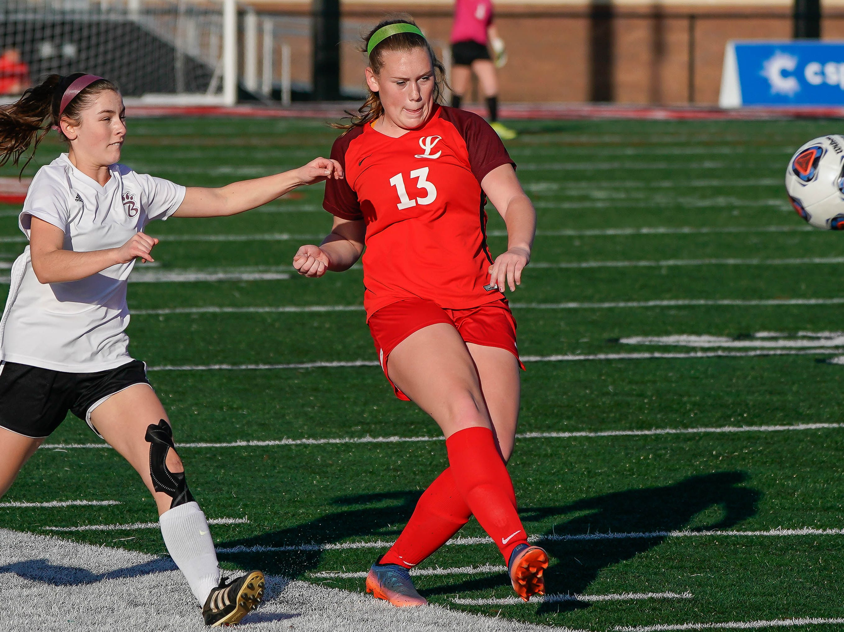 Lafayette's Sara Moore (13) kicks a ball against Long Beach during the MHSAA 5A Girls Soccer Championships held at Brandon High School in Brandon, MS, Saturday February 9, 2019.(Bob Smith-For The Clarion Ledger)