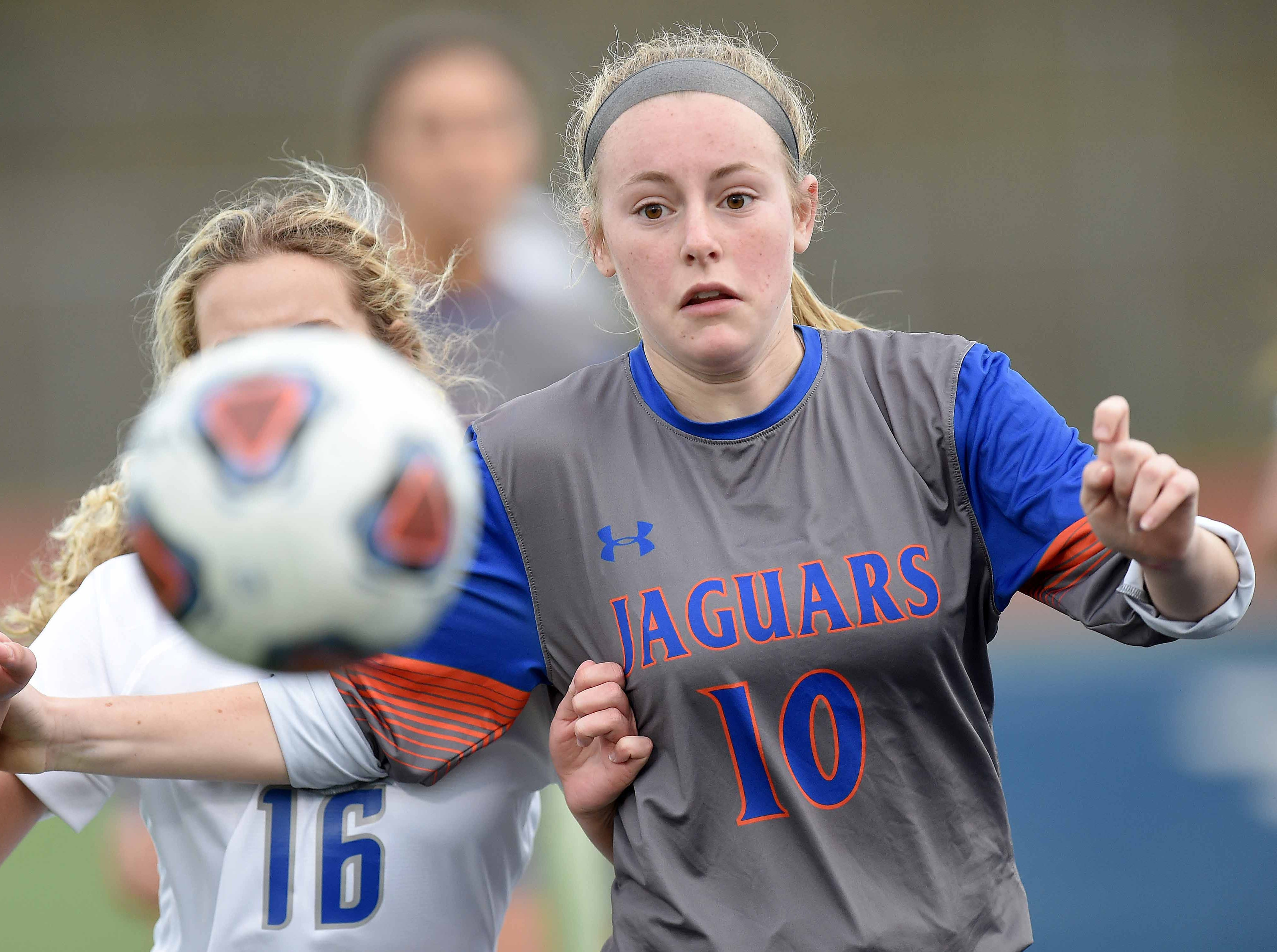 Madison Central's Lane Taylor (10) and Ocean Spring's Sydney Johnson (16) vie for a throw in at the Class 6A state championship in the MHSAA BlueCross Blue Shield of Mississippi Soccer Classic on Saturday, February 9, 2019, at Ridgeland High School in Ridgeland, Miss.
