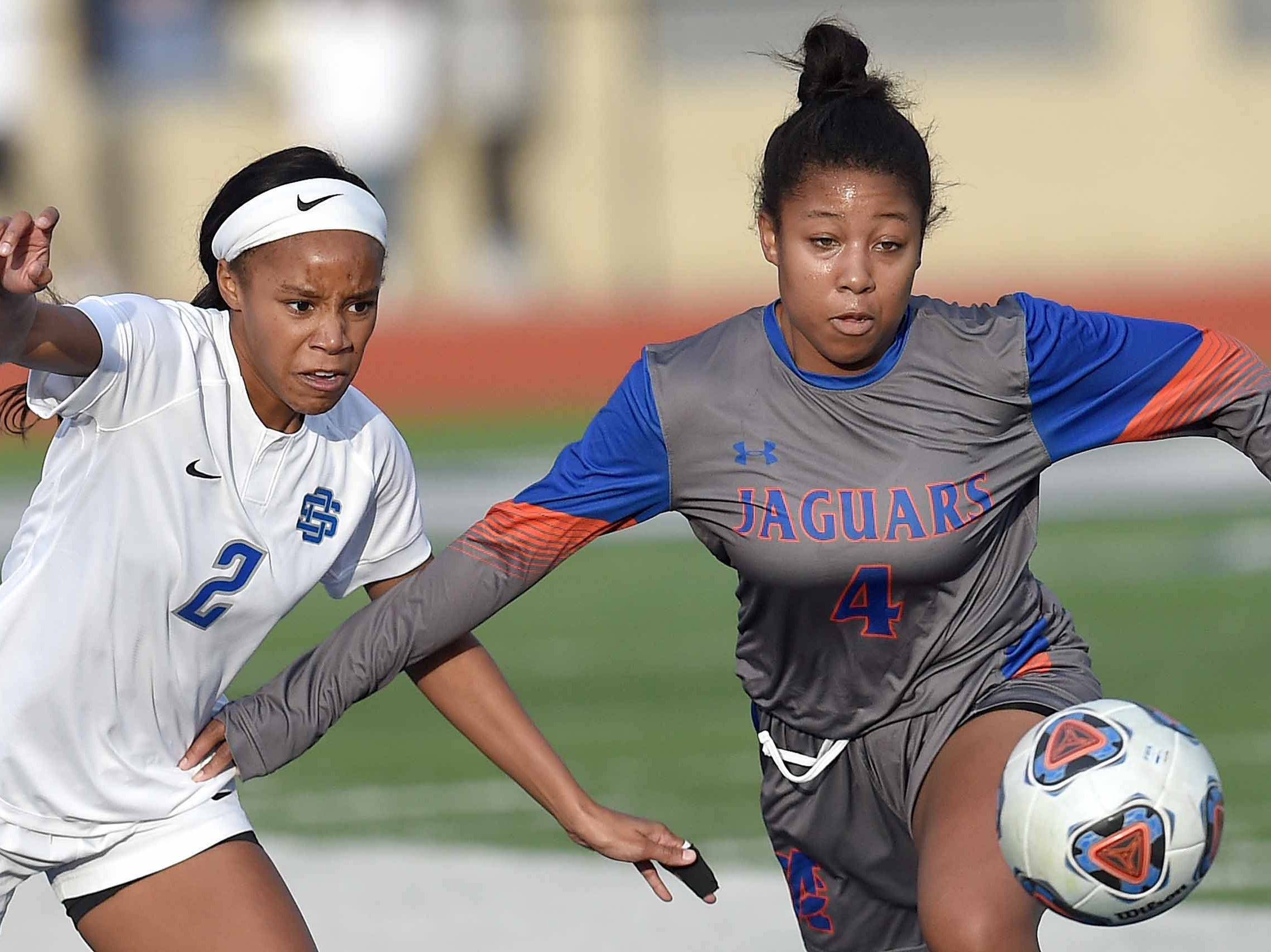 Madison Central's Elaysha Travis (4) goes after the ball against Ocean Springs' Kinsley Harmon (2) in the Class 6A state championship in the MHSAA BlueCross Blue Shield of Mississippi Soccer Classic on Saturday, February 9, 2019, at Ridgeland High School in Ridgeland, Miss.