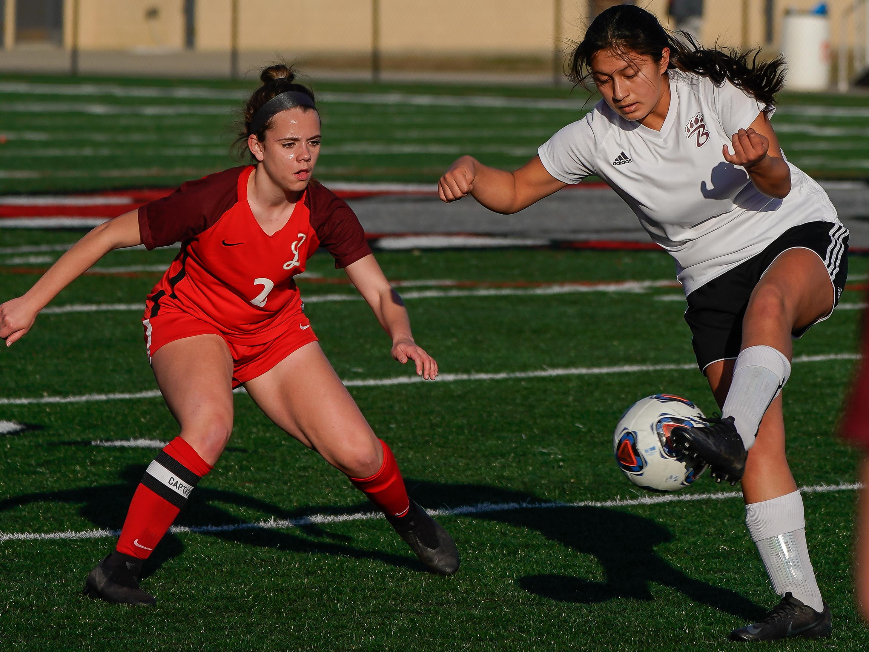 Long Beach's Nathalie Salvador (26) kicks a ball against Lafayette's Marissa Harrison (2) during the MHSAA 5A Girls Soccer Championships held at Brandon High School in Brandon, MS, Saturday February 9, 2019.(Bob Smith-For The Clarion Ledger)
