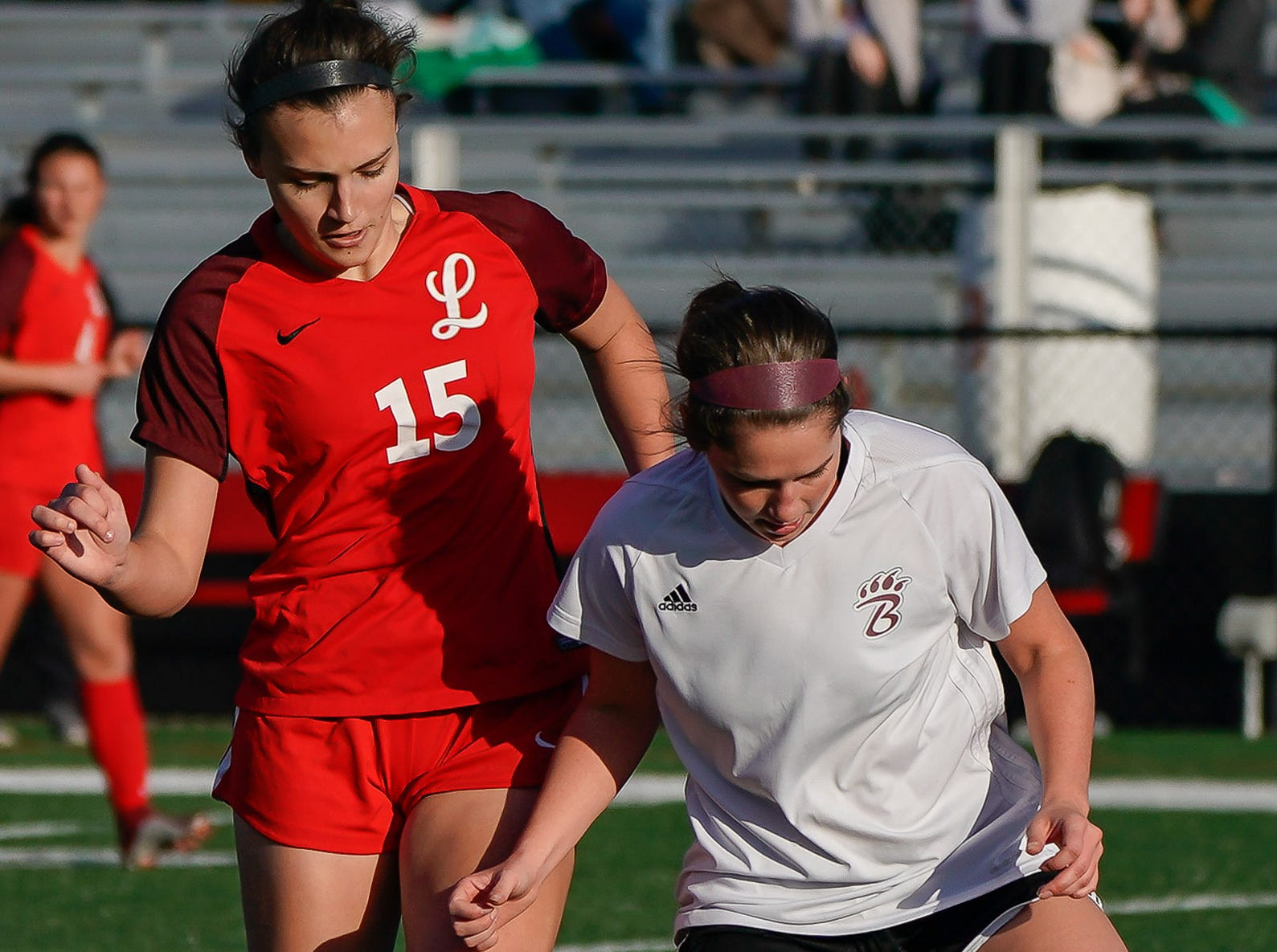 Lafayette's Hudson Lindsay (15) goes after a ball against Long Beach's Alexa Beets (6) during the MHSAA 5A Girls Soccer Championships held at Brandon High School in Brandon, MS, Saturday February 9, 2019.(Bob Smith-For The Clarion Ledger)