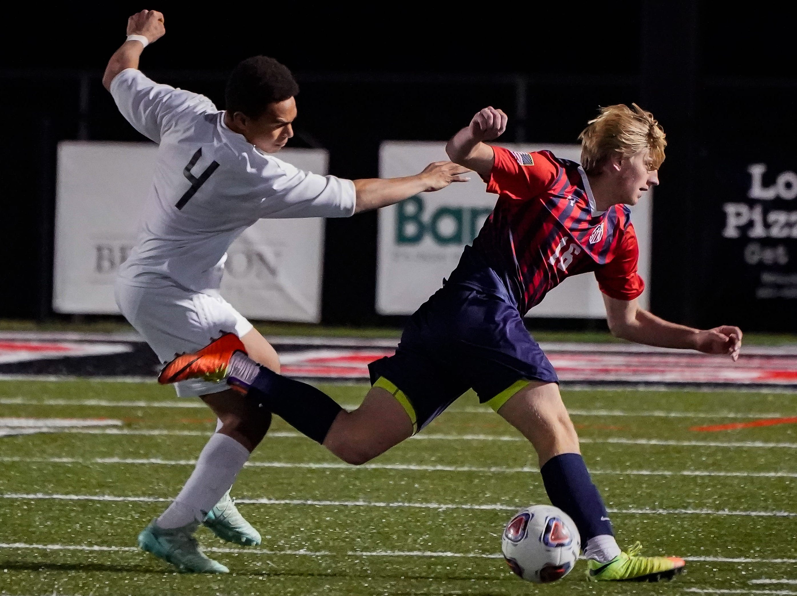Lewisburg's Blaine Galbraith (16) is pushed from behind by Long Beach's Noah Shockley (4) during the MHSAA 5A Boys Soccer Championships held at Brandon High School in Brandon, MS, Saturday February 9, 2019.(Bob Smith-For The Clarion Ledger)