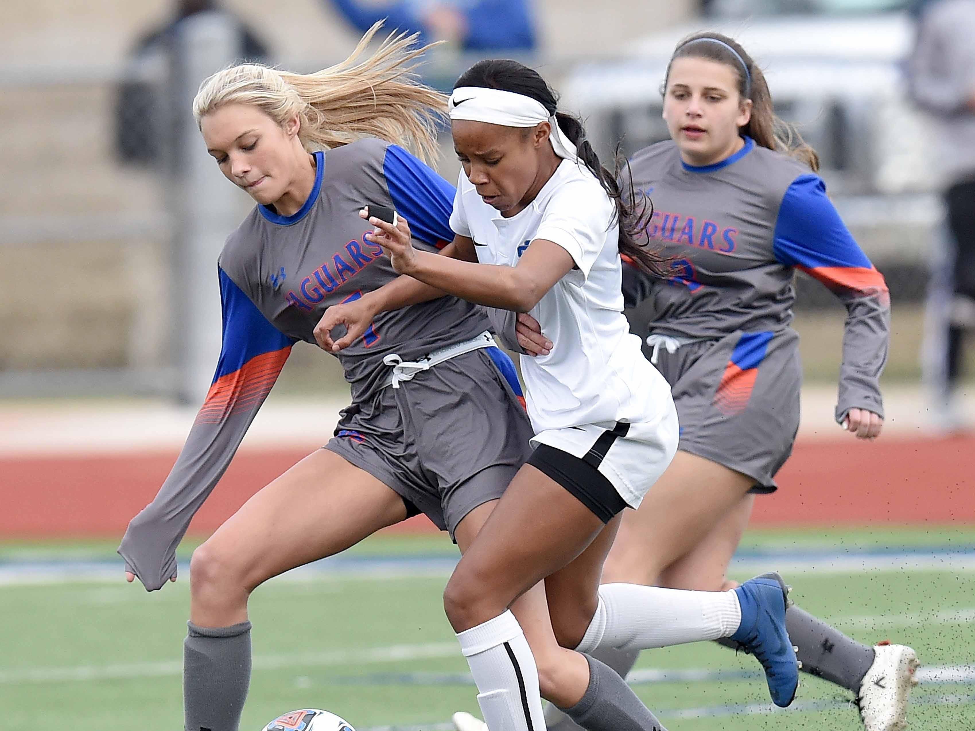Madison Central's Caroline Parker (left) goes after the ball against Ocean Springs' Kinsley Harmon (2) in the Class 6A state championship in the MHSAA BlueCross Blue Shield of Mississippi Soccer Classic on Saturday, February 9, 2019, at Ridgeland High School in Ridgeland, Miss.