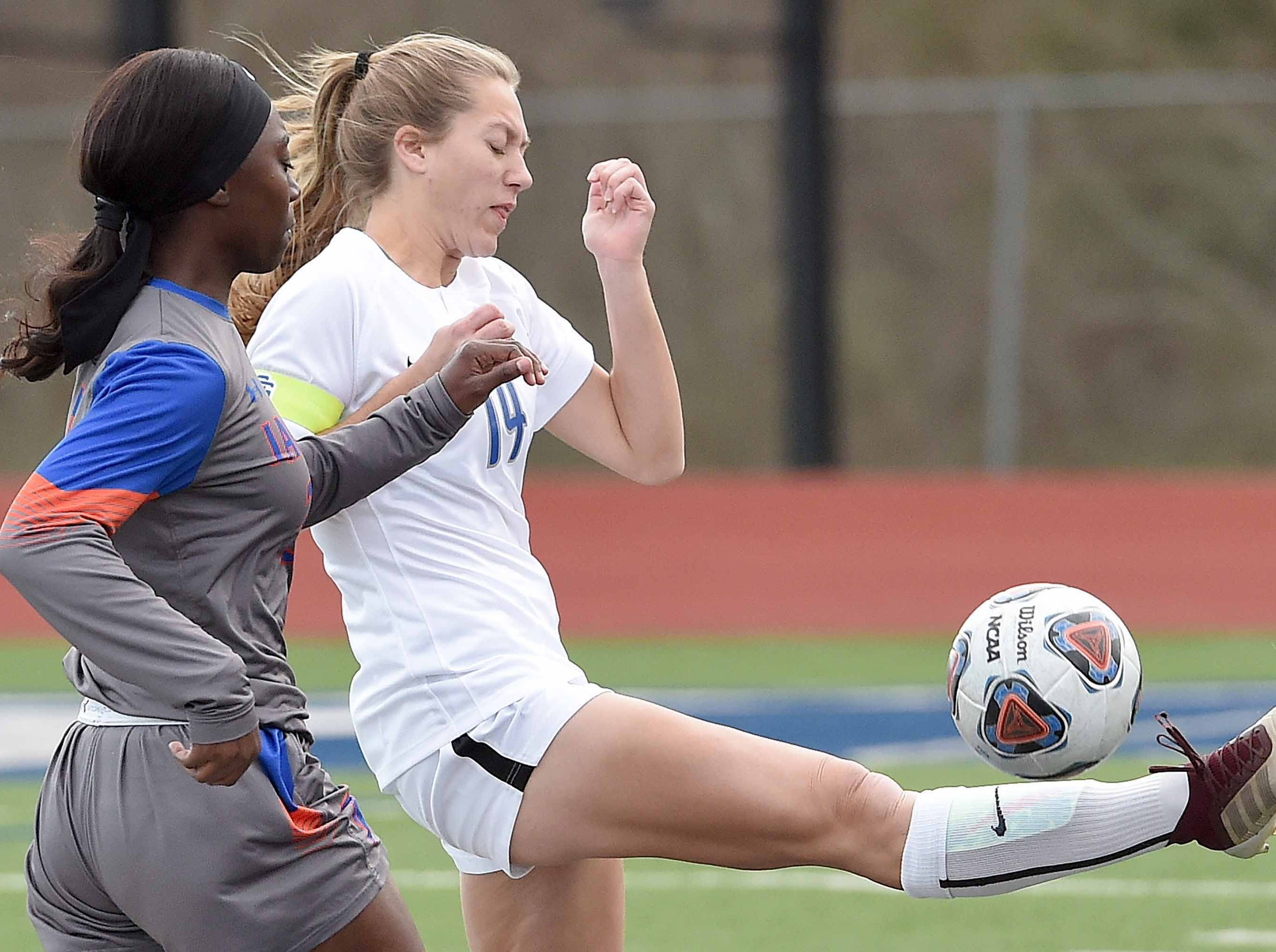 Ocean Springs' Kaylee Foster (14) clears the ball against Madison Central in the Class 6A state championship in the MHSAA BlueCross Blue Shield of Mississippi Soccer Classic on Saturday, February 9, 2019, at Ridgeland High School in Ridgeland, Miss.