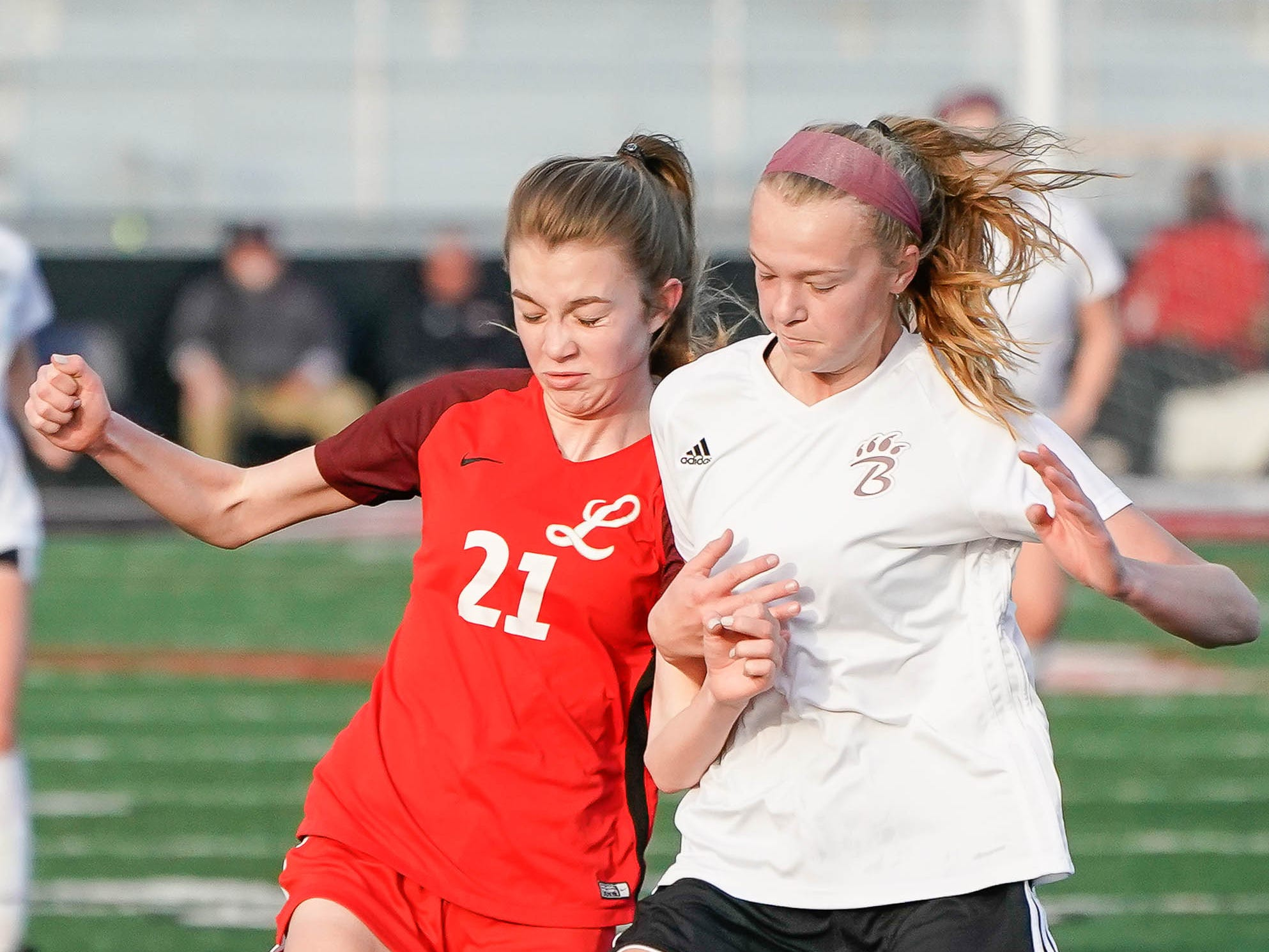 Lafayette's (21) battles with against Long Beach's Lauren Bennett for a possession during the MHSAA 5A Girls Soccer Championships held at Brandon High School in Brandon, MS, Saturday February 9, 2019.(Bob Smith-For The Clarion Ledger)