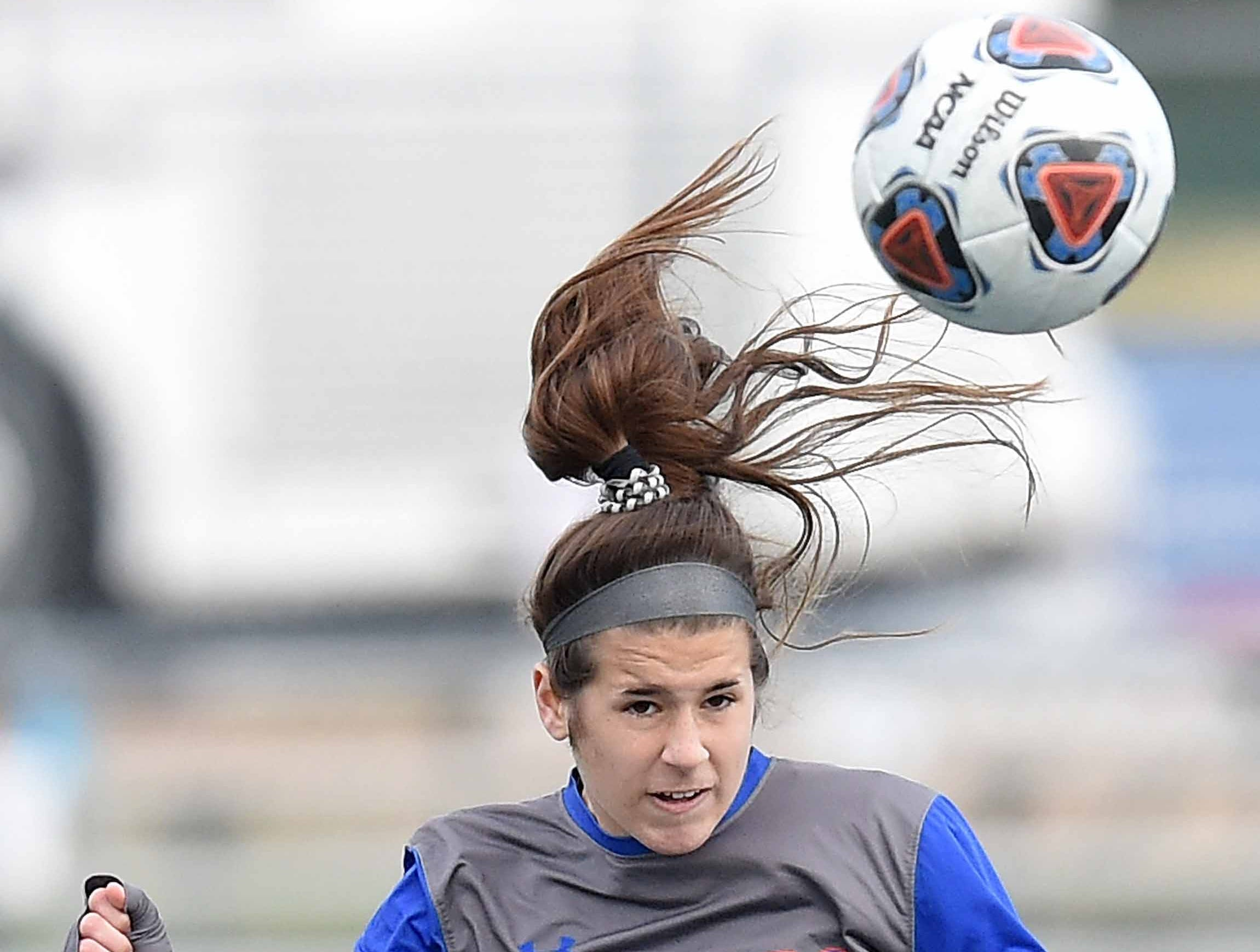 Madison Central's Olivia Deslatte (20) heads the ball against Ocean Springs in the Class 6A state championship in the MHSAA BlueCross Blue Shield of Mississippi Soccer Classic on Saturday, February 9, 2019, at Ridgeland High School in Ridgeland, Miss.