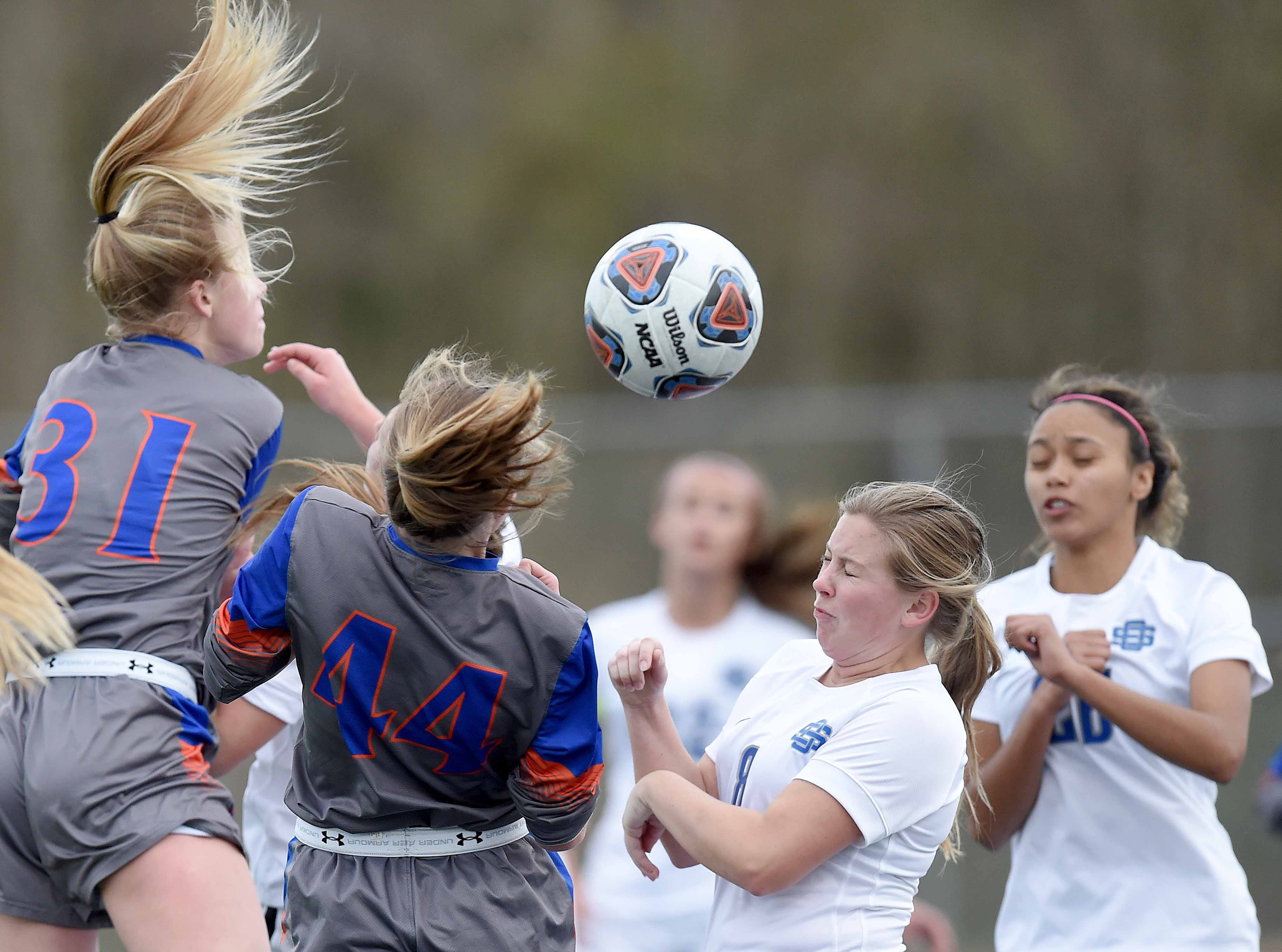 The hair is flying as the ball comes into the box on a corner kick Class 6A state championship in the MHSAA BlueCross Blue Shield of Mississippi Soccer Classic on Saturday, February 9, 2019, at Ridgeland High School in Ridgeland, Miss.