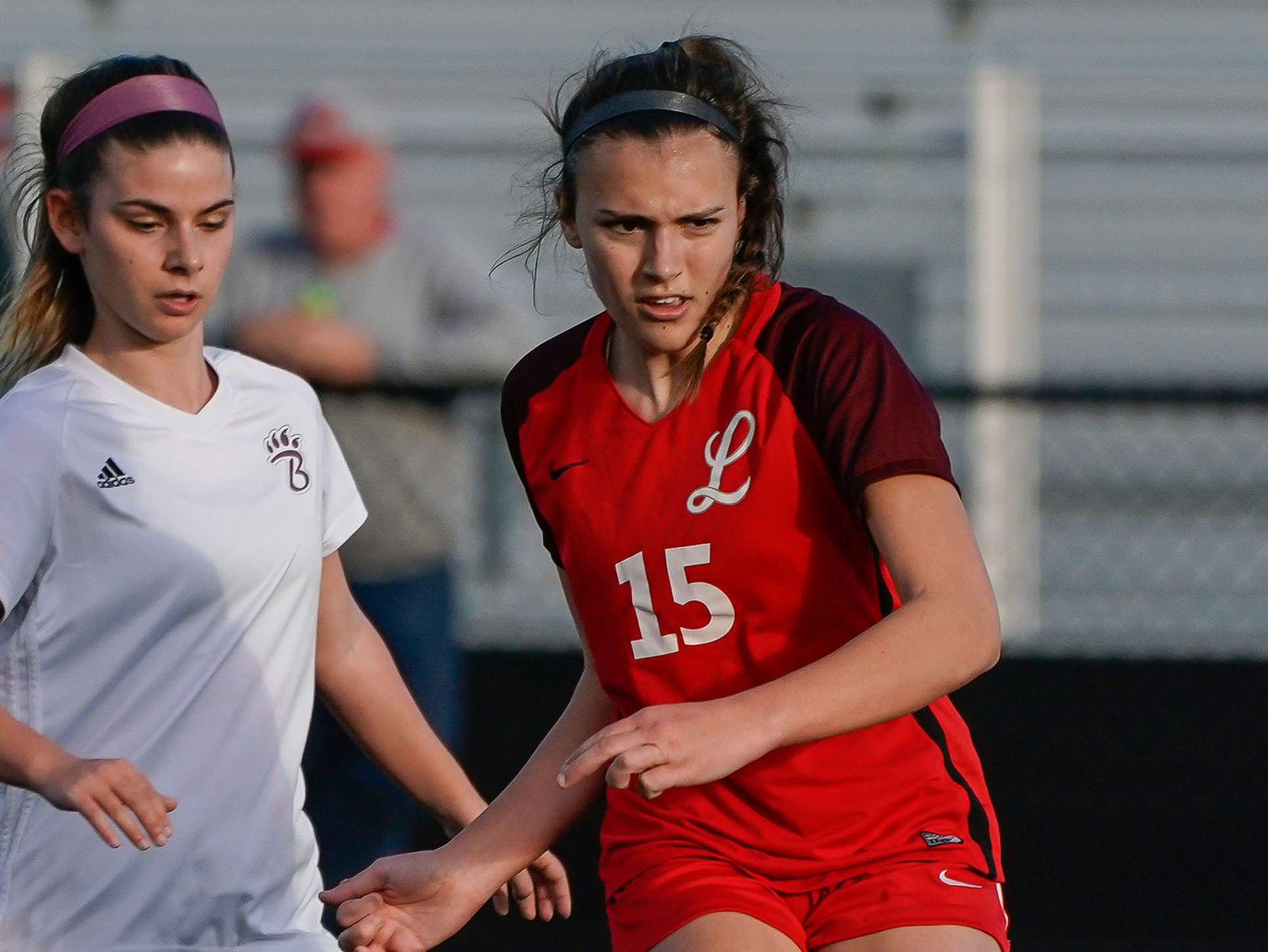 Lafayette's Hudson Lindsay (15) kicks a ball against Long Beach during the MHSAA 5A Girls Soccer Championships held at Brandon High School in Brandon, MS, Saturday February 9, 2019.(Bob Smith-For The Clarion Ledger)