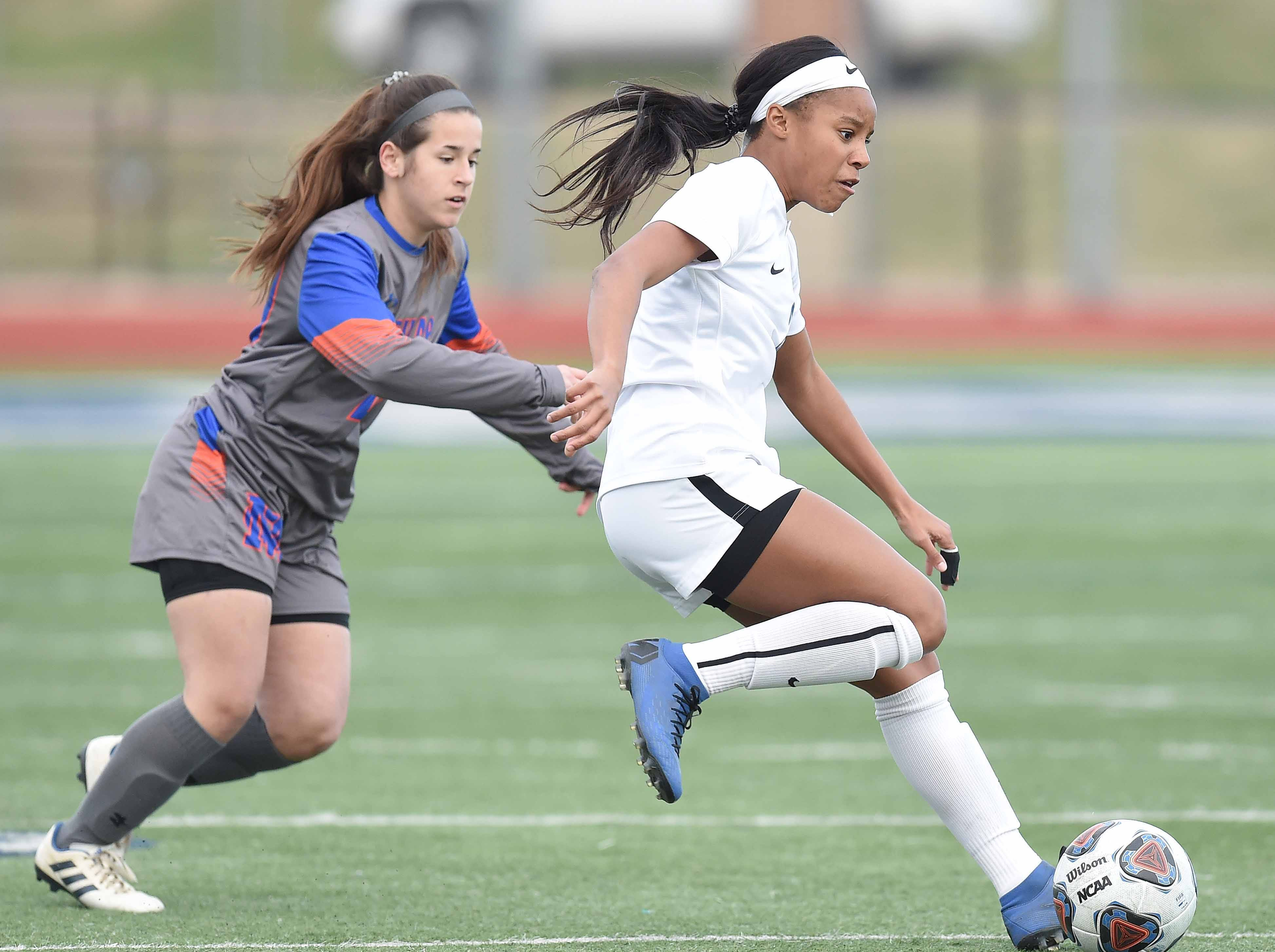 Ocean Springs' Kinsley Harmon (2) looks to pass against Madison Central in the Class 6A state championship in the MHSAA BlueCross Blue Shield of Mississippi Soccer Classic on Saturday, February 9, 2019, at Ridgeland High School in Ridgeland, Miss.