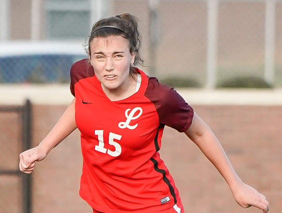 Lafayette's Hudson Lindsay (15) heads a ball against Long Beach during the MHSAA 5A Girls Soccer Championships held at Brandon High School in Brandon, MS, Saturday February 9, 2019.(Bob Smith-For The Clarion Ledger)